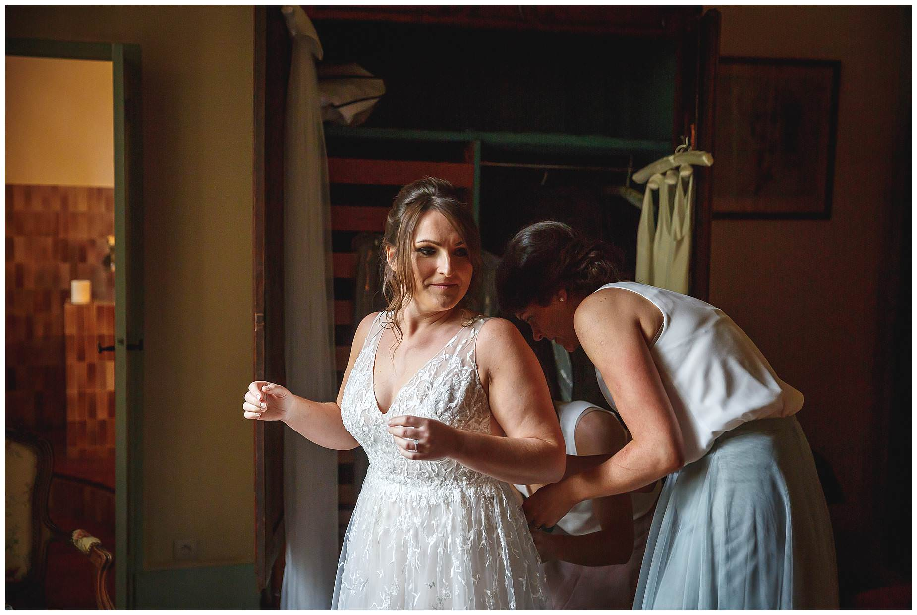 bride getting into dress at chateau de Vergieres
