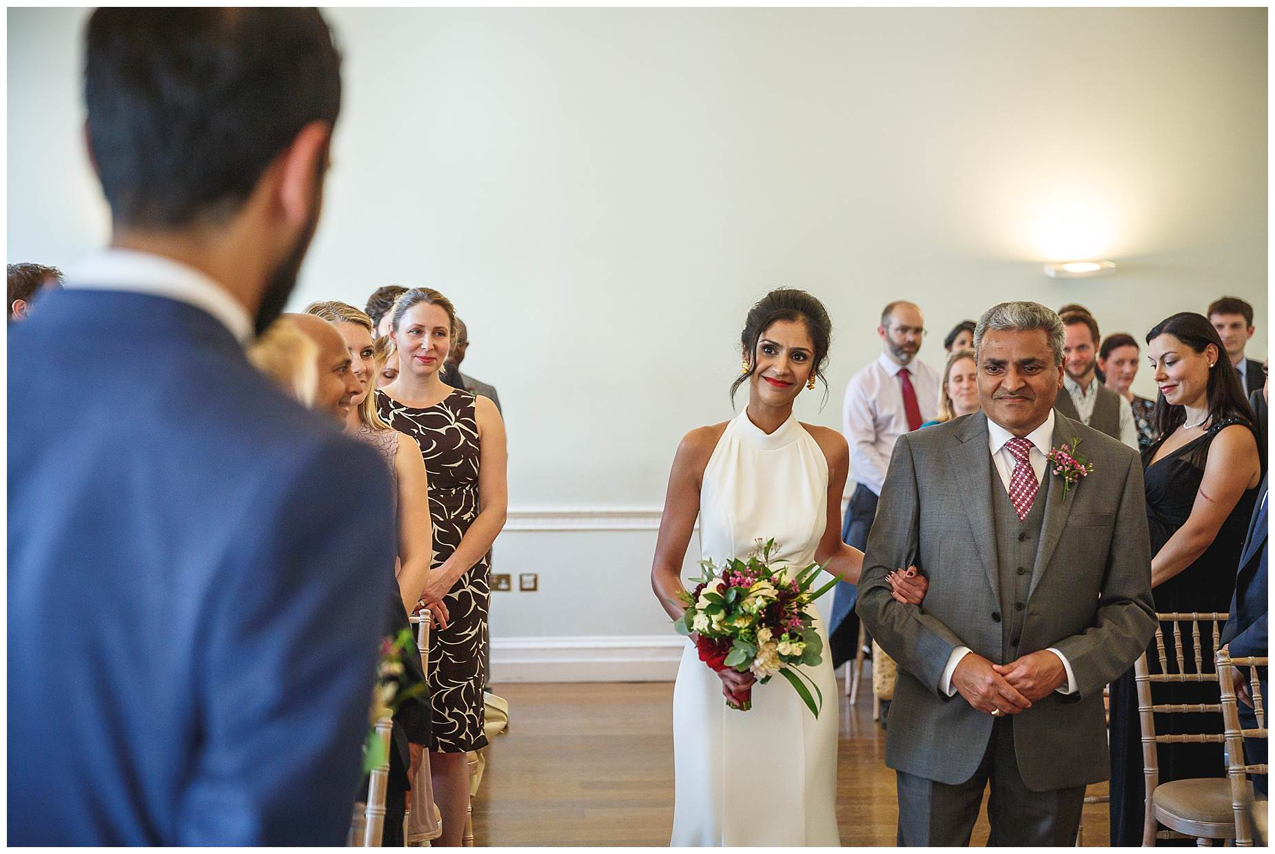 Bride walking down the aisle at Asia House London