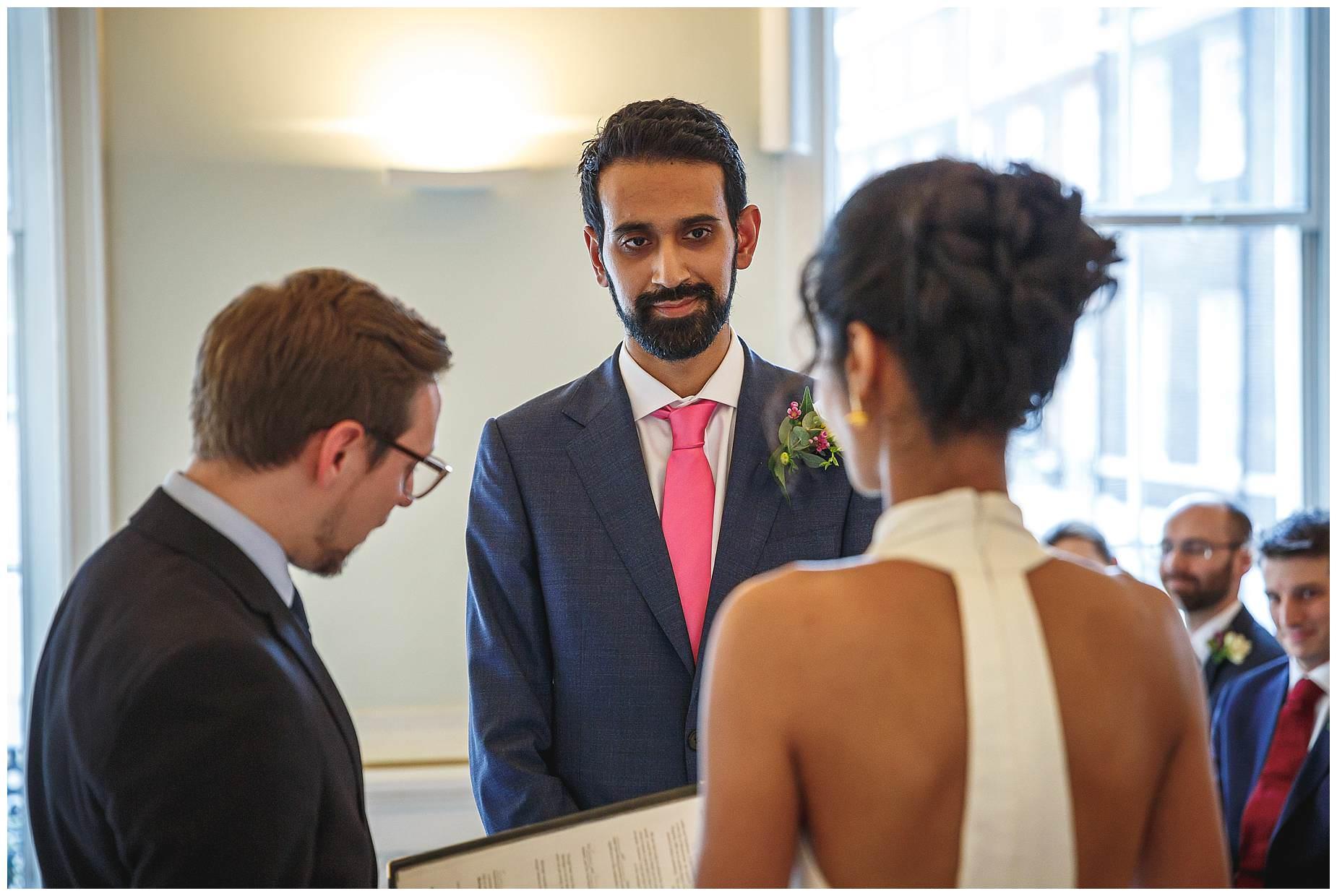 Groom looking at bride Asia House Wedding