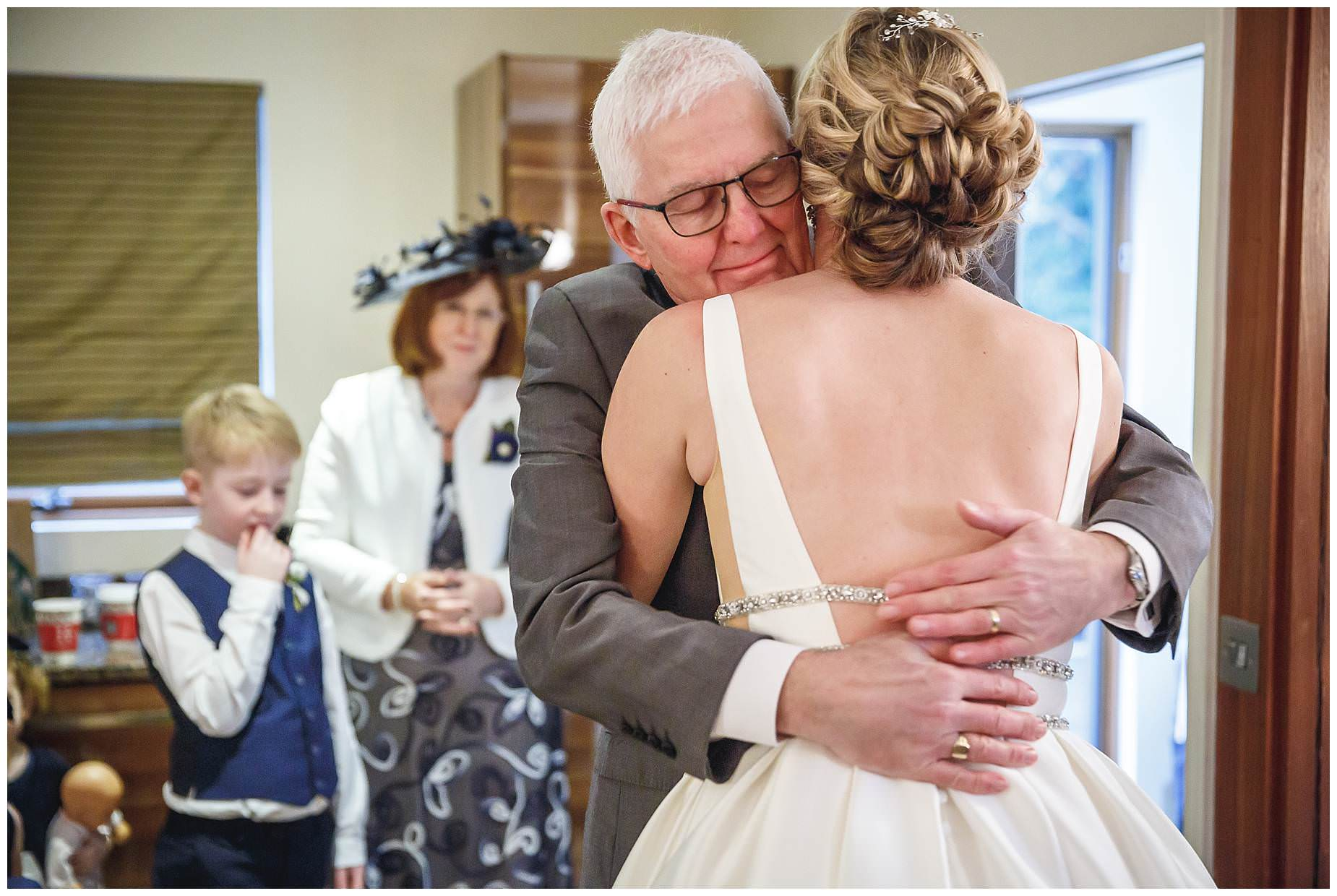 Dad hugs bride