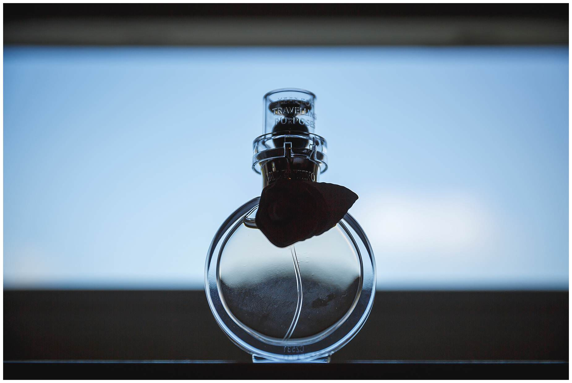 perfume bottle on window