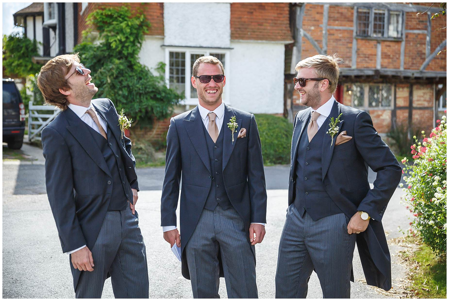 the boys laughing at wedding