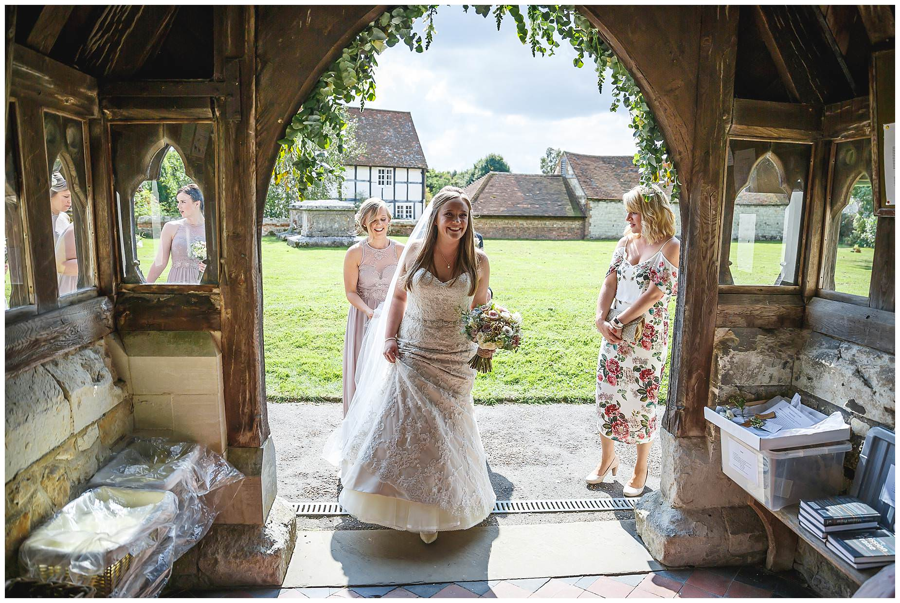 bride arrives for her Bury Court Barn Wedding