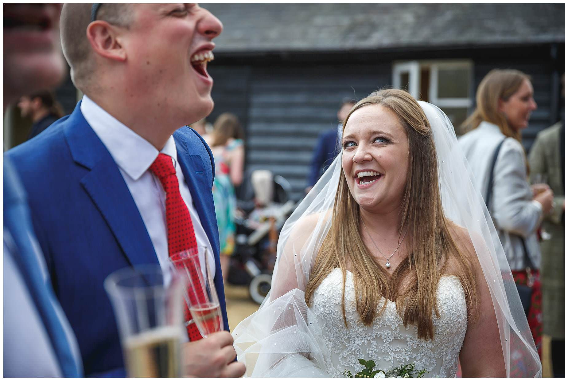 Bury Court Barn Wedding bride laughing