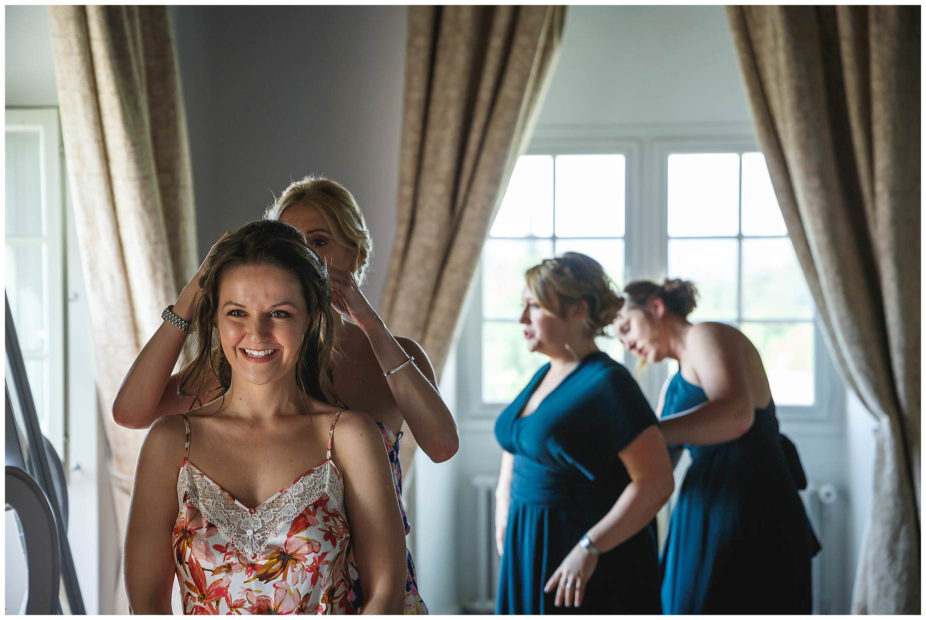 Bridesmaids adjusting hair