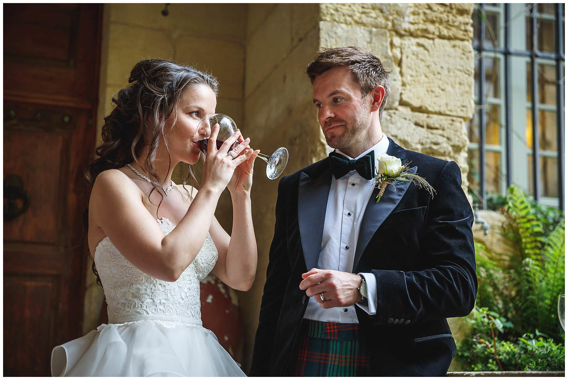 bride drinking wine in ceremony