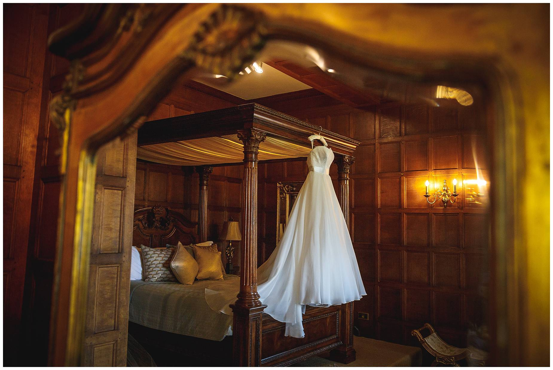 wedding dress hanging up at Hengrave Hall