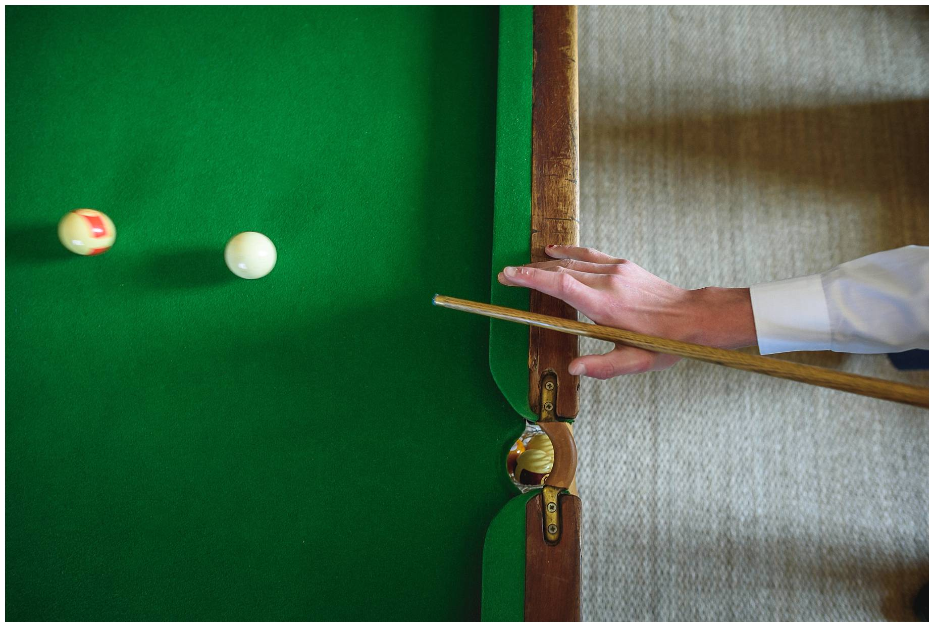 close up of hands playing pool