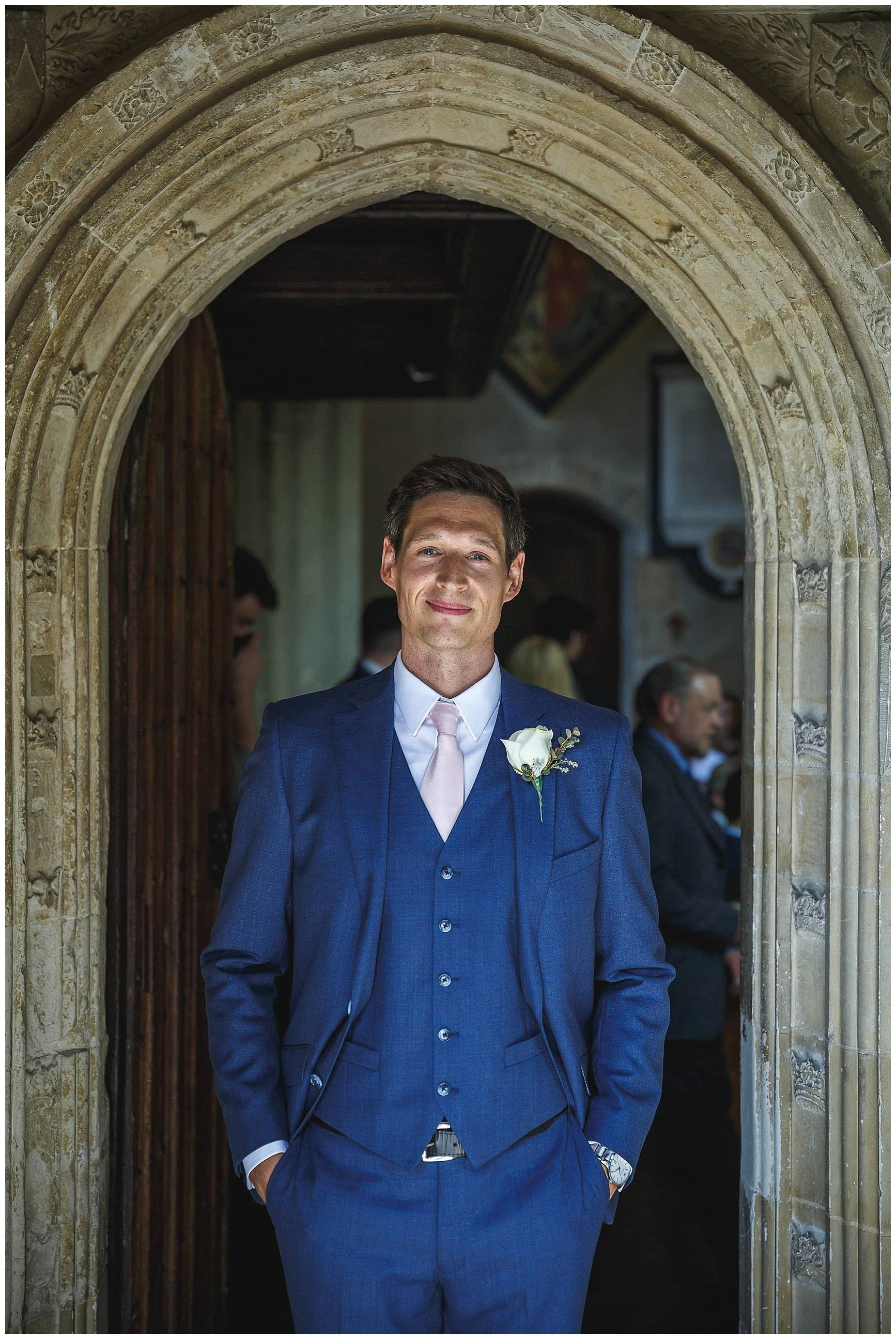 Groom in church door