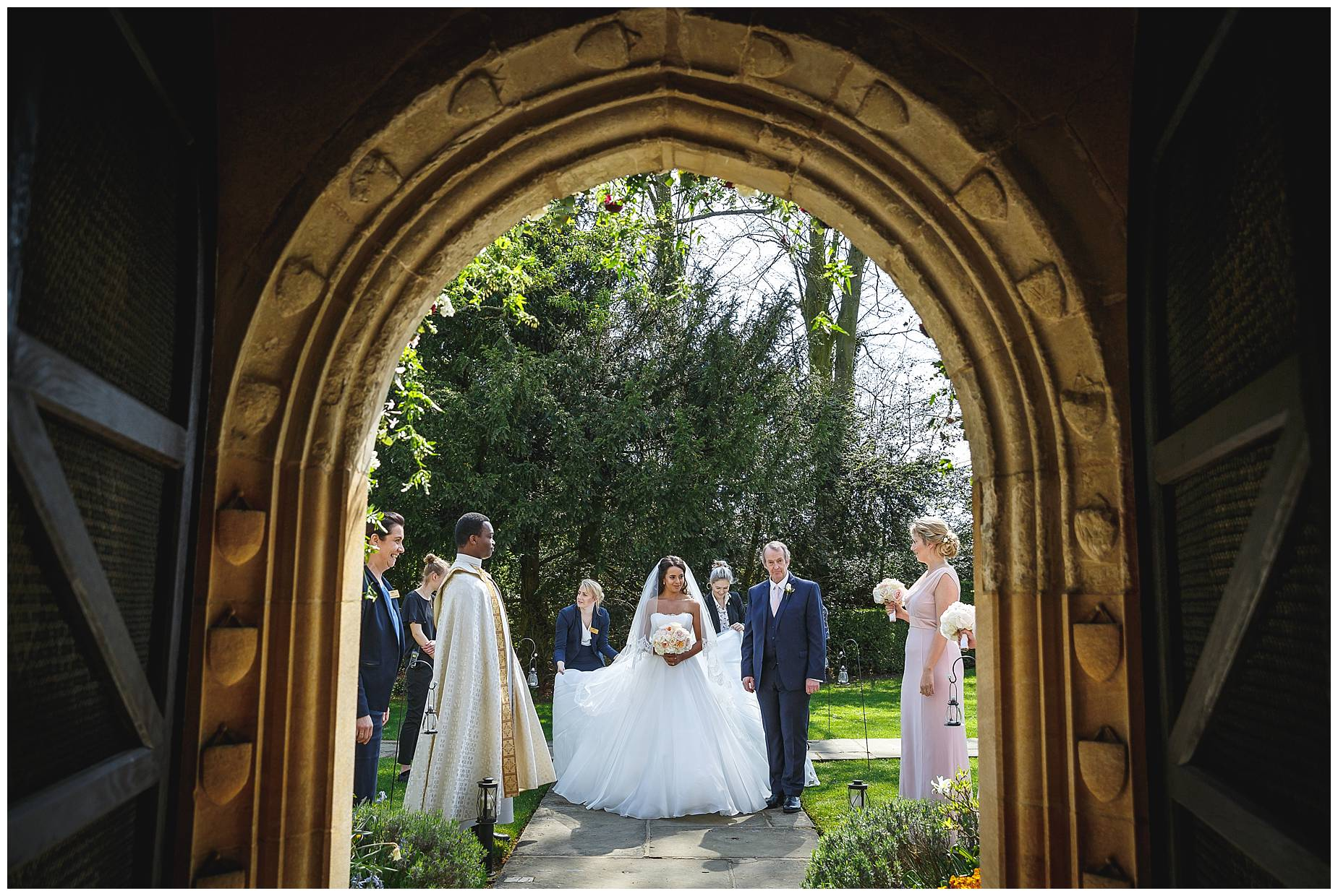 bride shot through archway