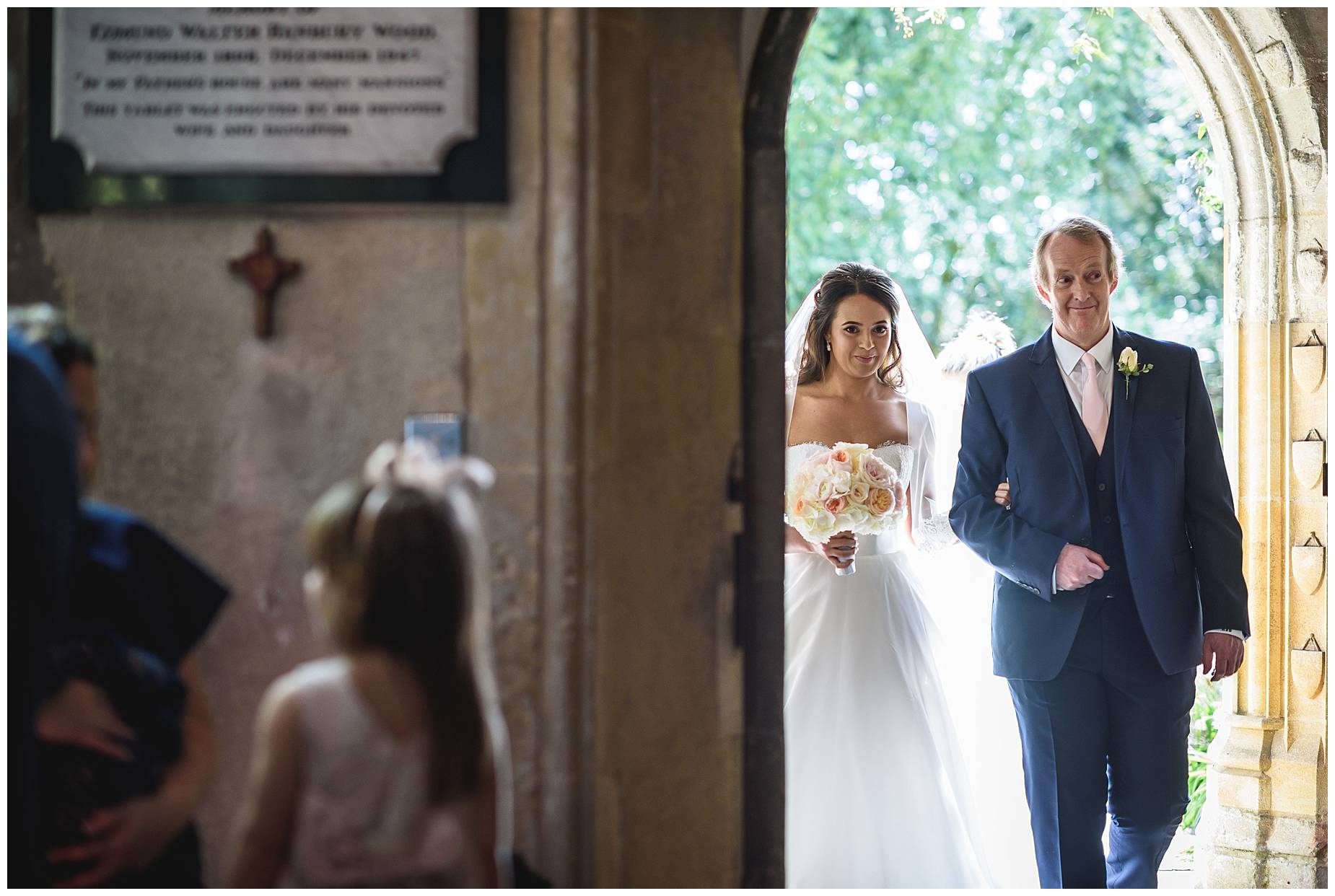 bride goes through door with Dad at Wedding Hengrave Hall