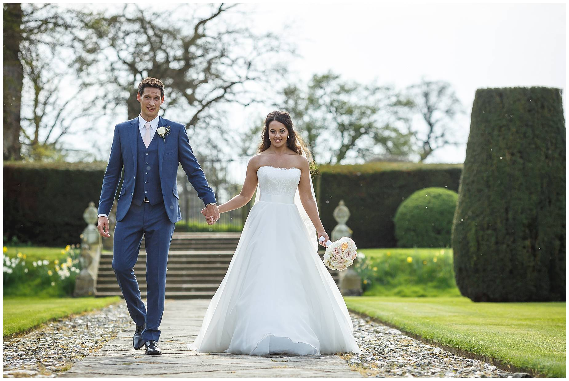 Wedding Hengrave Hall bride and groom walking