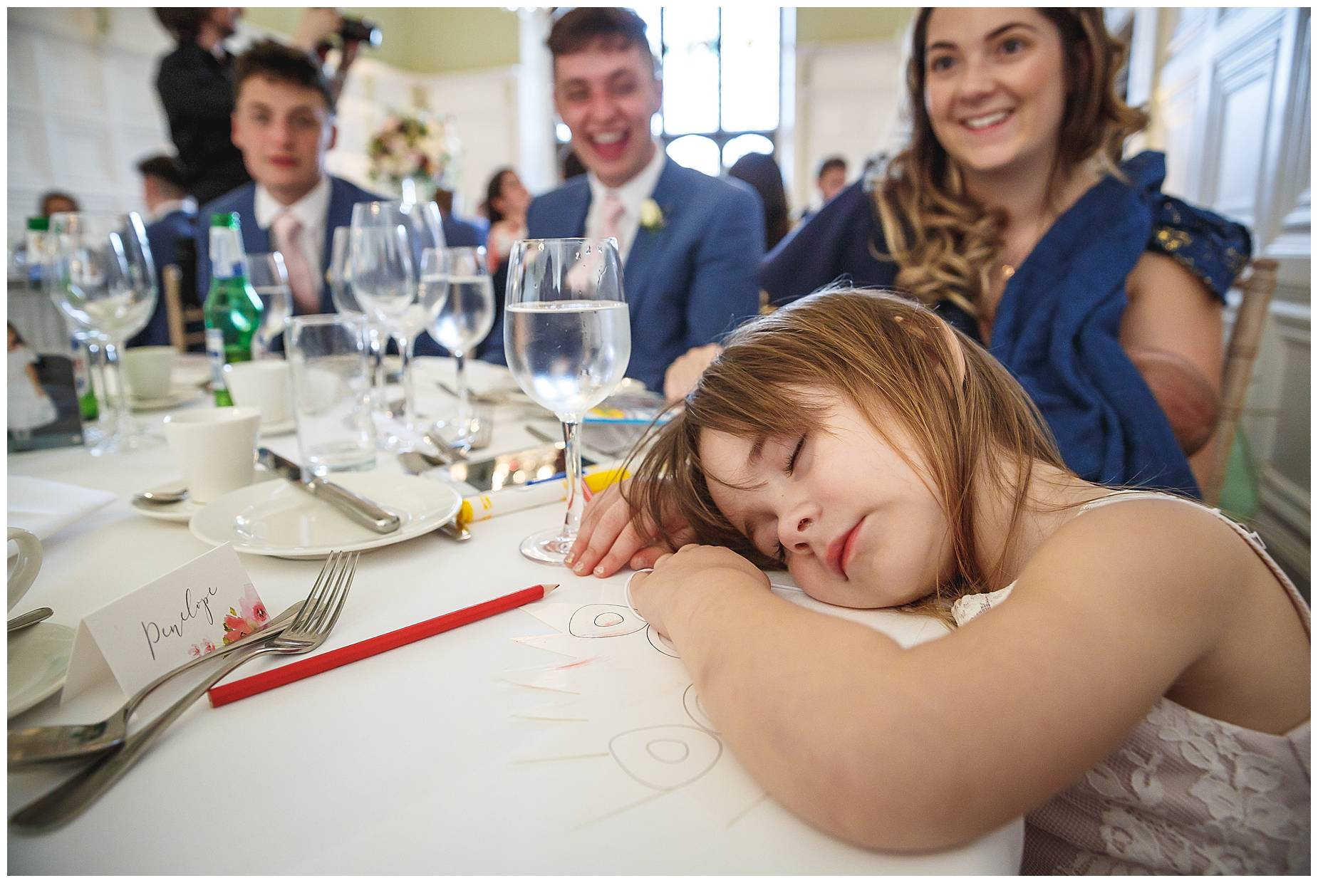 flower girl asleep at Hengrave Hall wedding