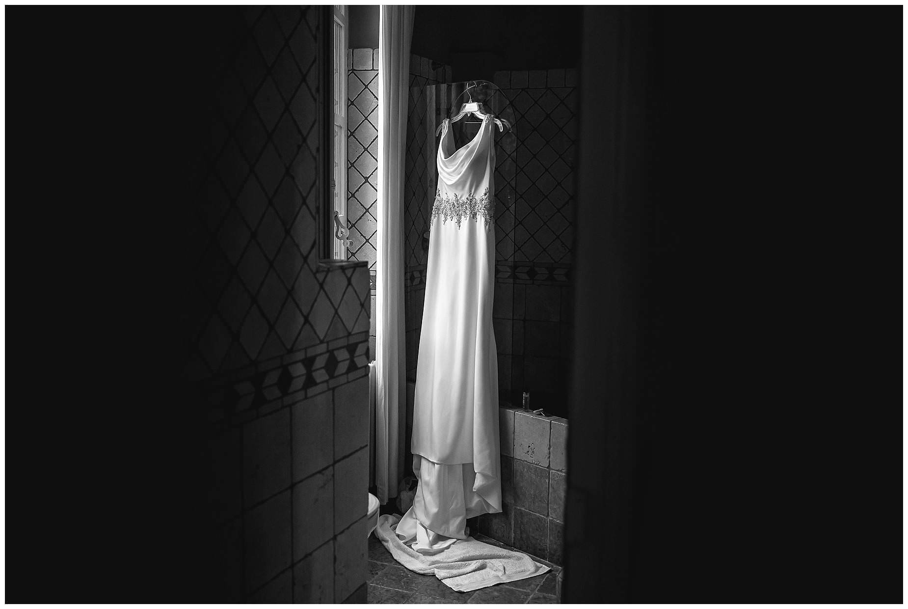 Wedding dress hanging at Chateau Roquelune Wedding