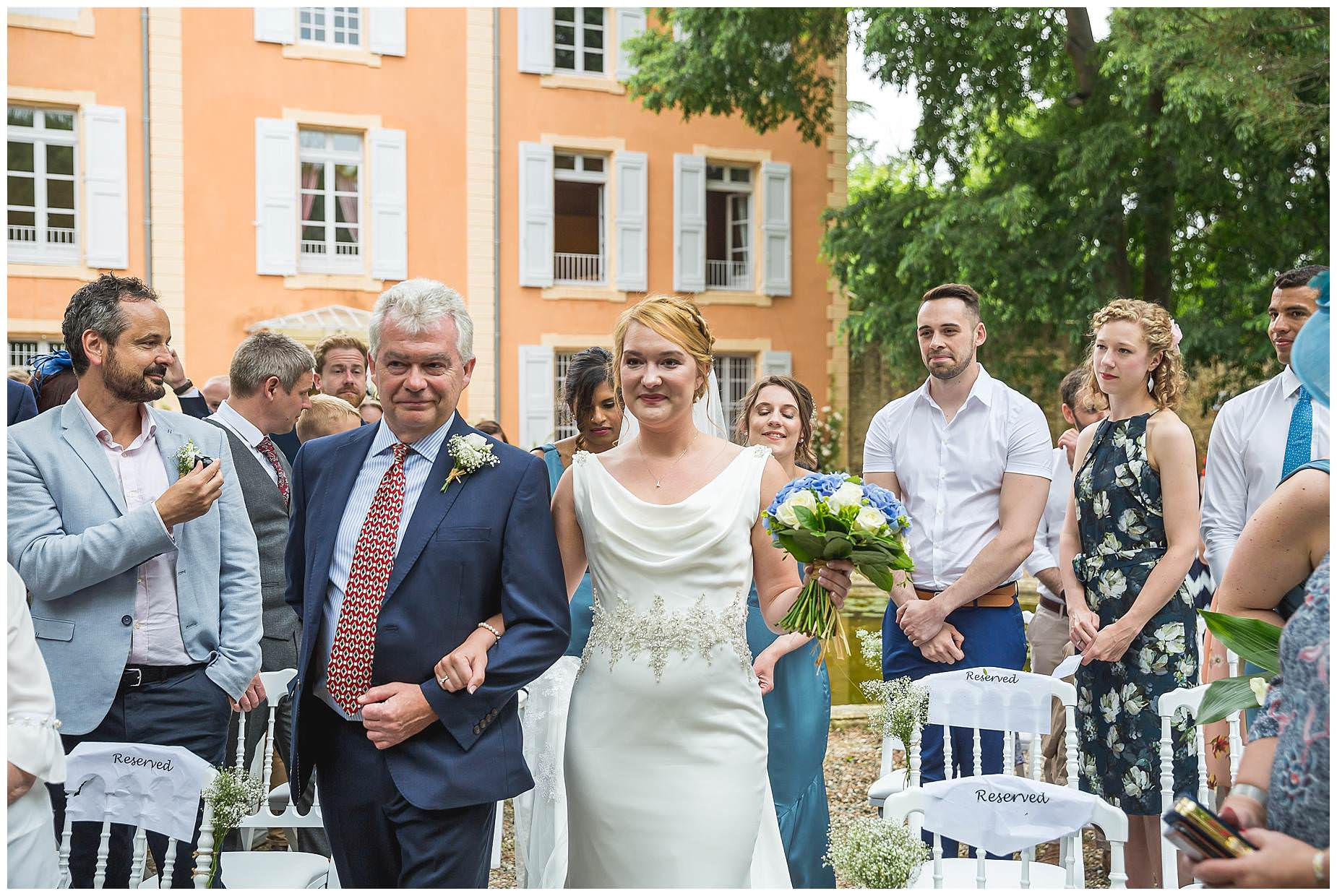 Walking down the aisle at Chateau Roquelune