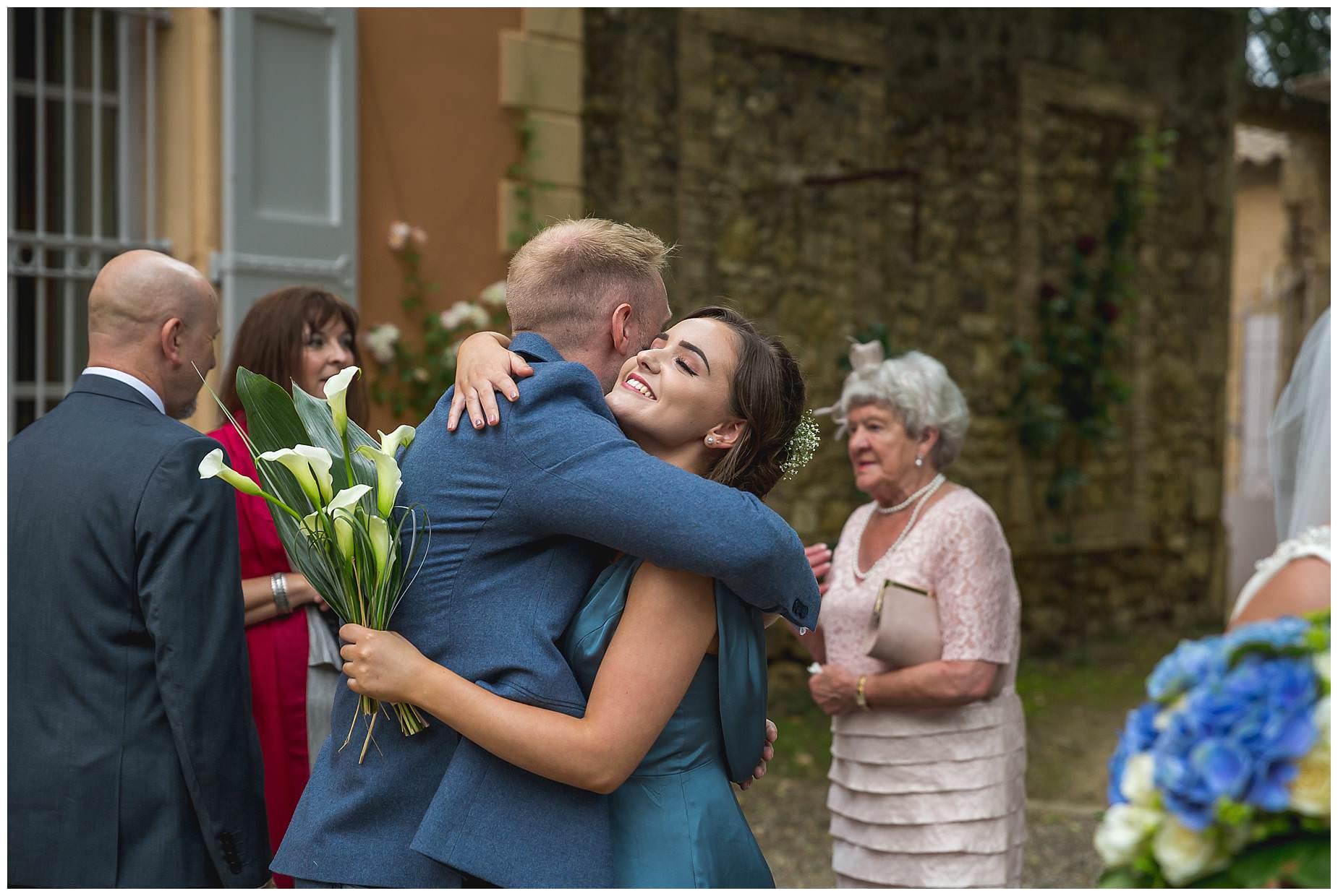 hugs for the groom