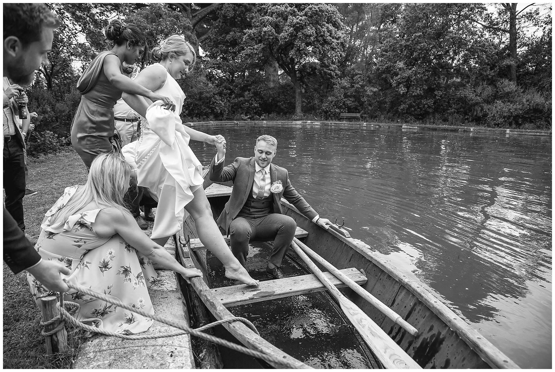 Bride gets into boat