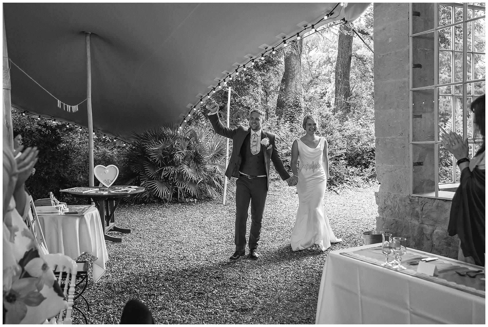 couple enter reception
