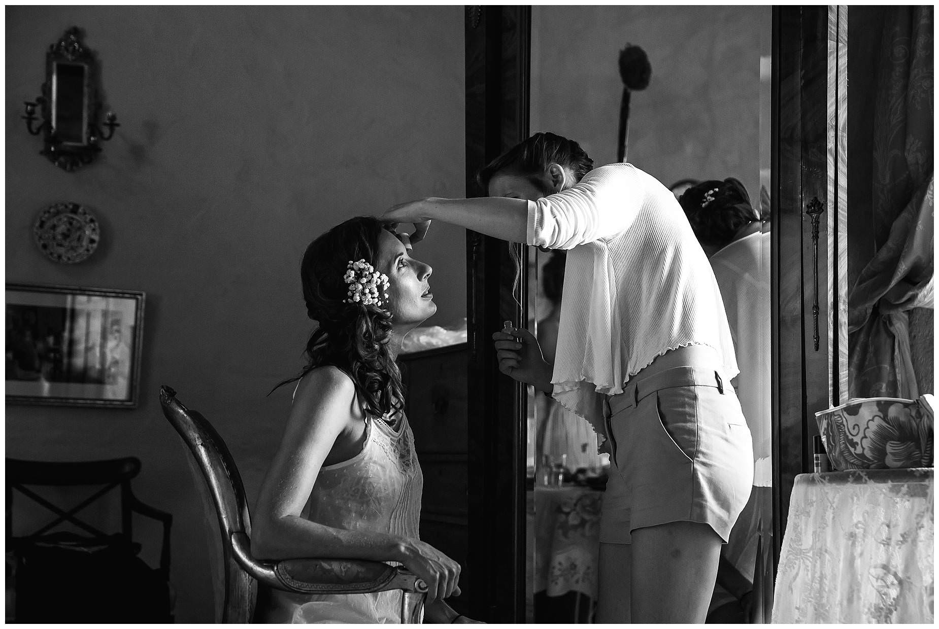bride having make up dne at The stunning courtyard at Chateau Brametourte