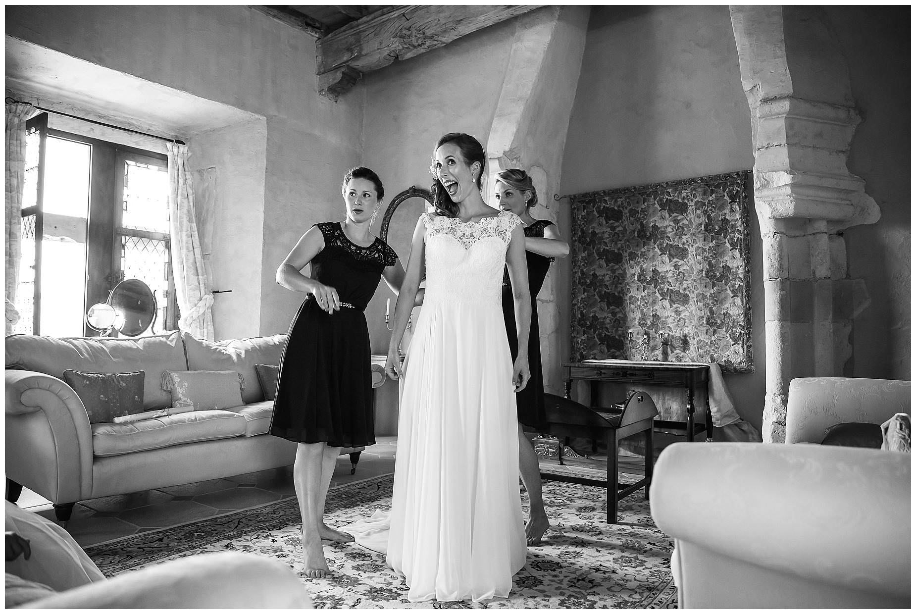 Bride gets ready at chateau brametourte