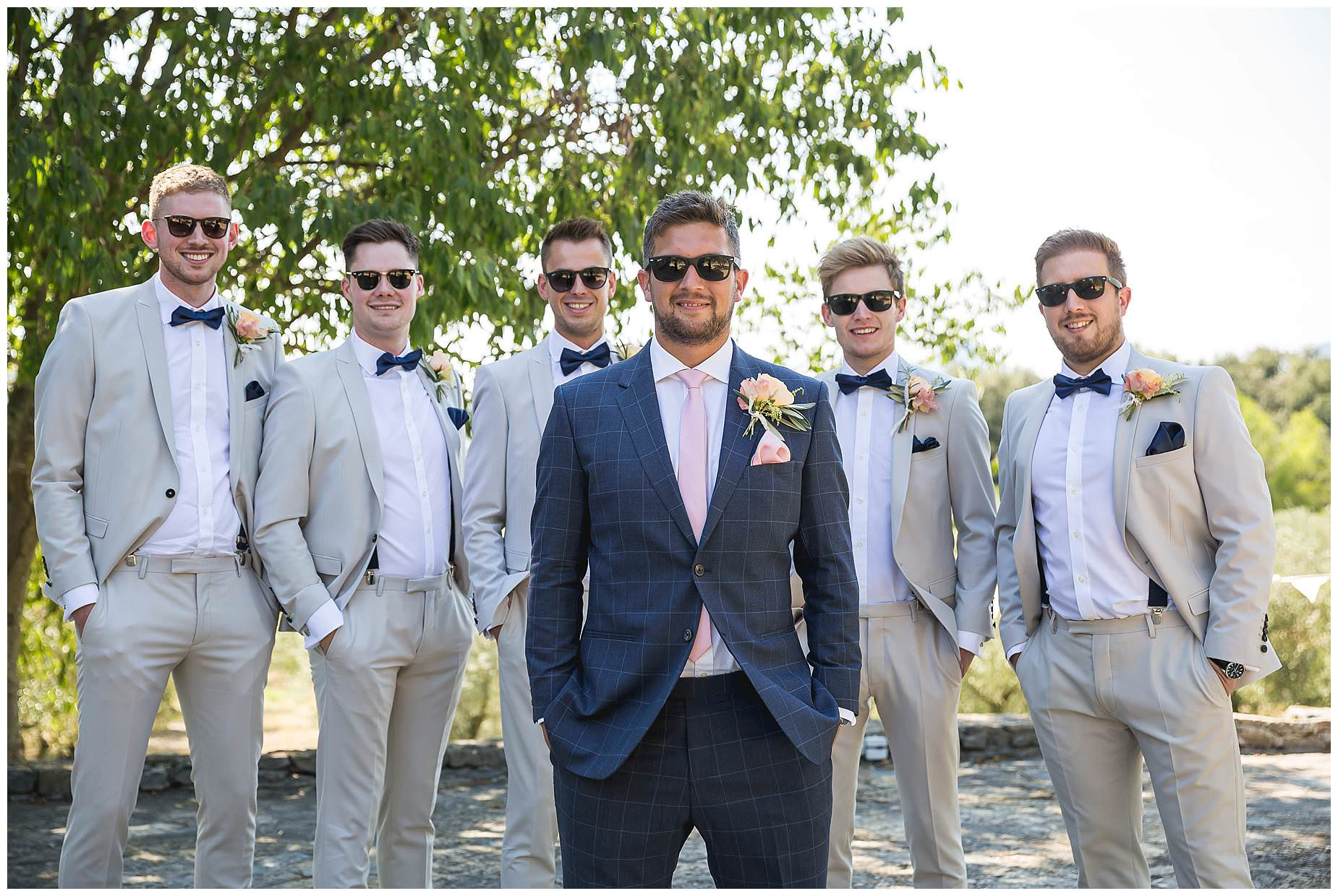 Boys ready for the wedding. Tan suits with bow ties