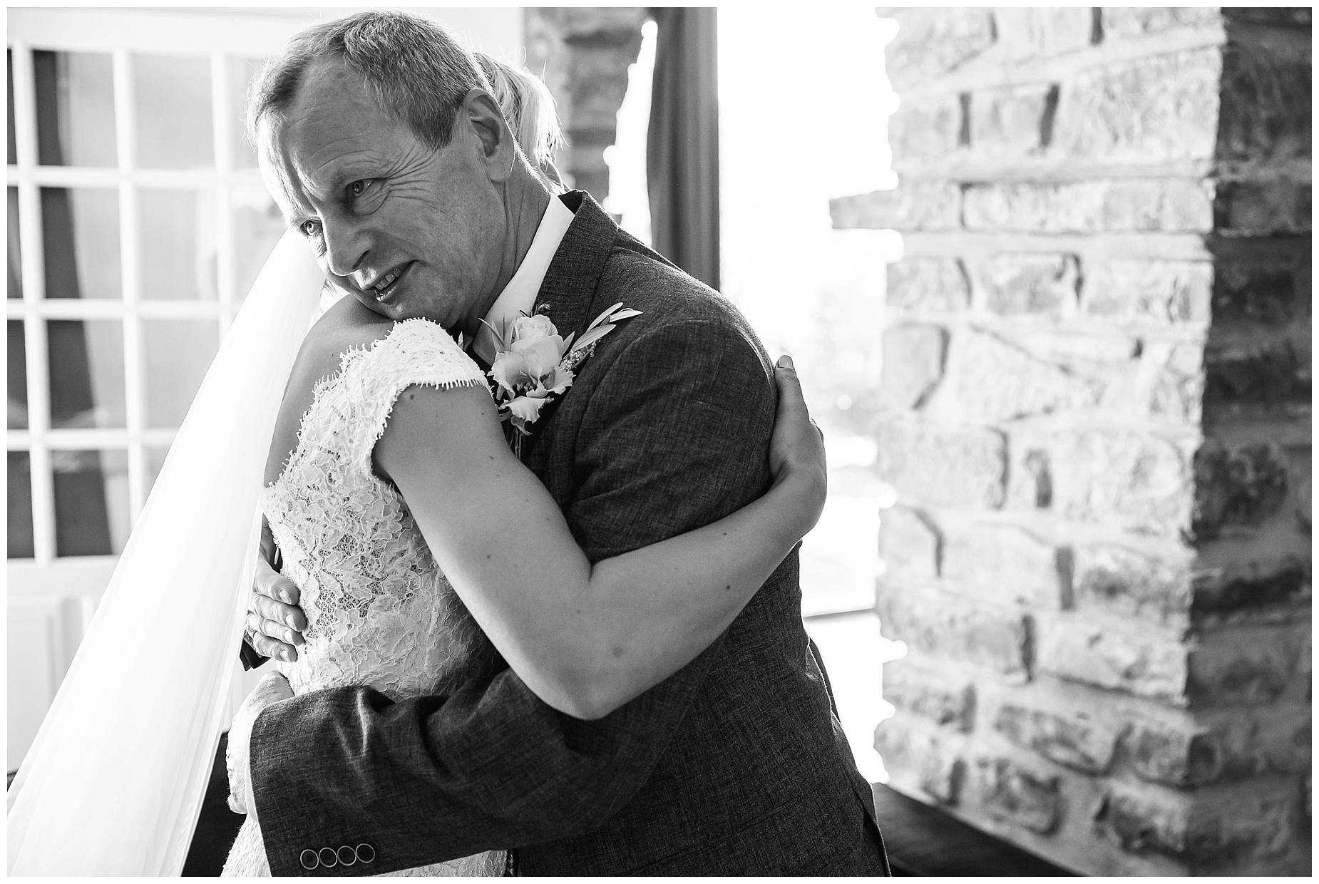 hug between father and daughter before her wedding