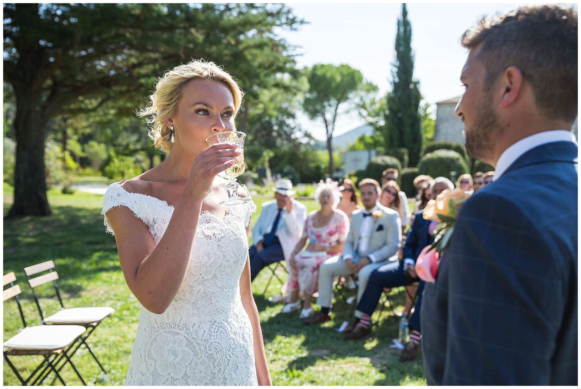 bride takes a sip from the loving cup