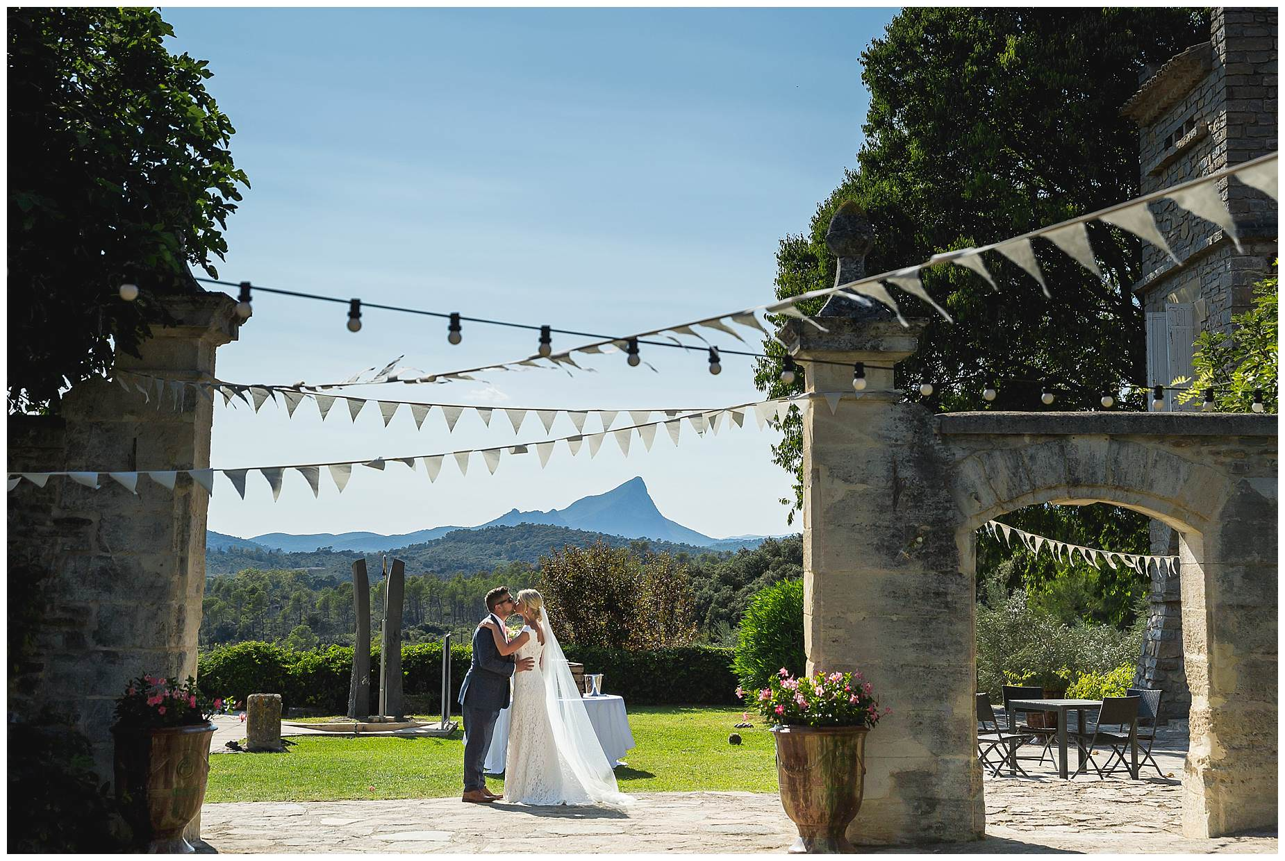 bride and groom kiss at Domaine Saint Germaine Wedding