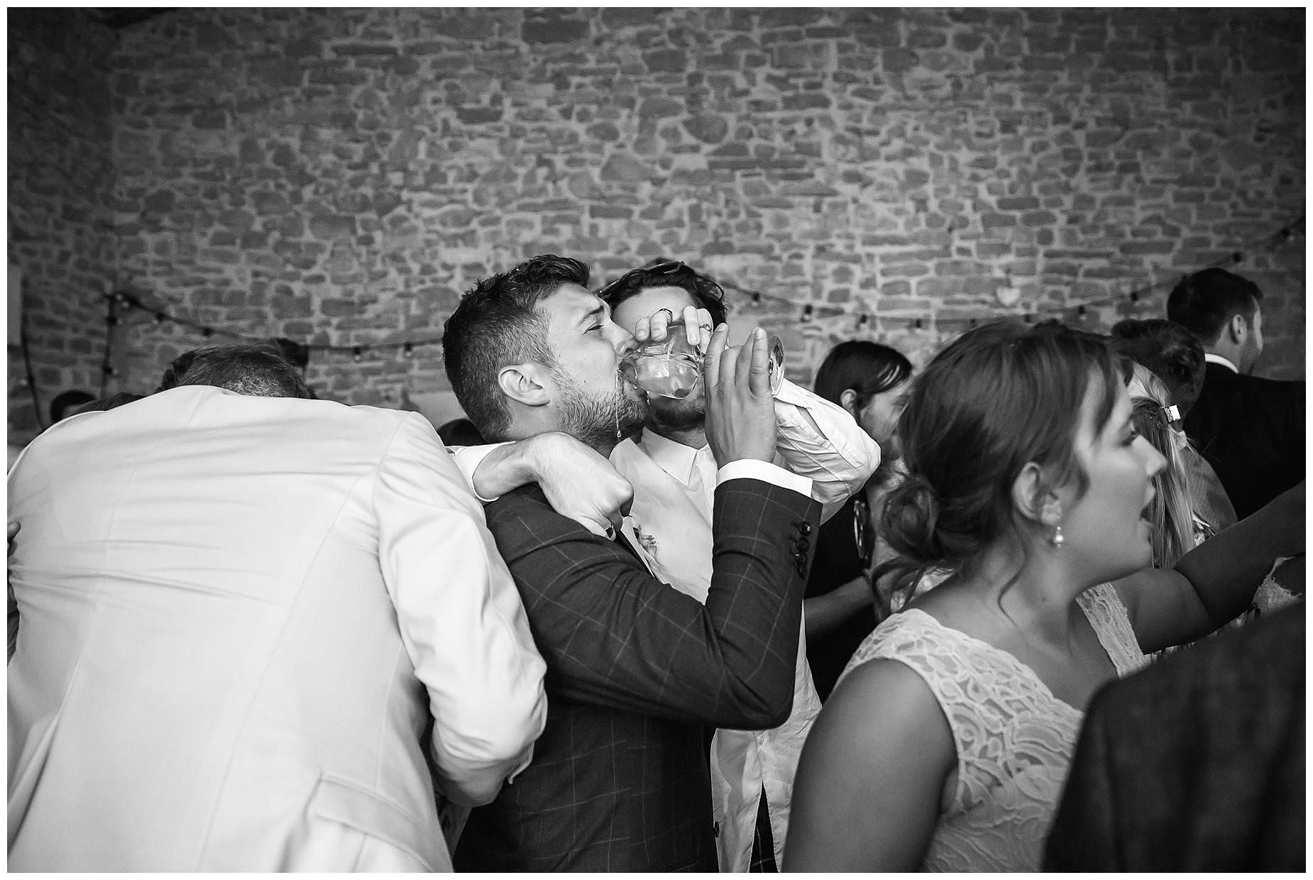 groom is forced to drink wine