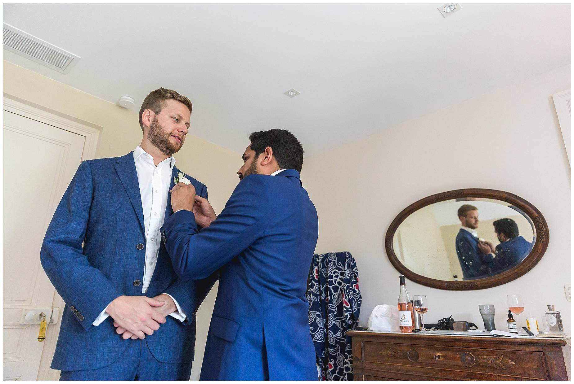the groom and best man get ready at Chateau de Malmont Wedding