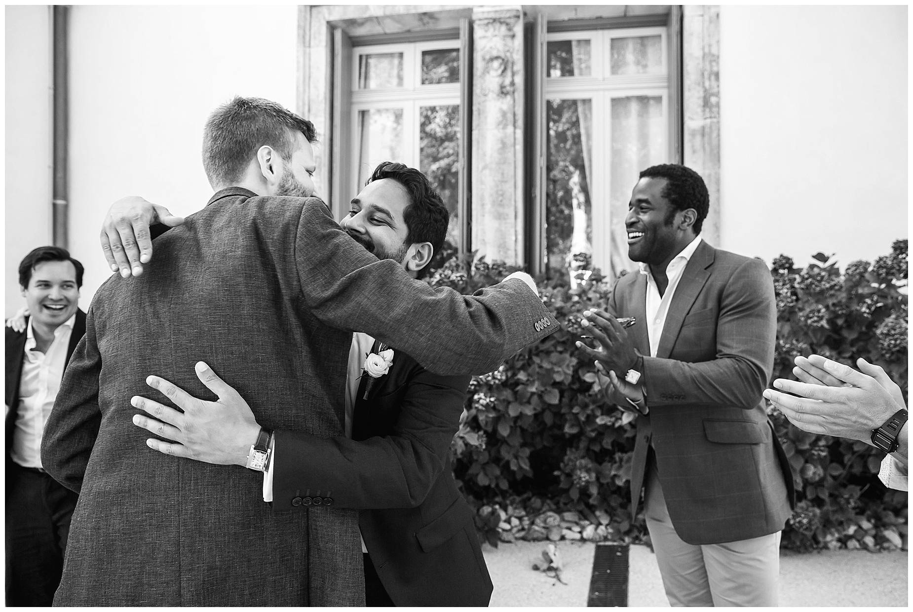 Groom and bestman hugs
