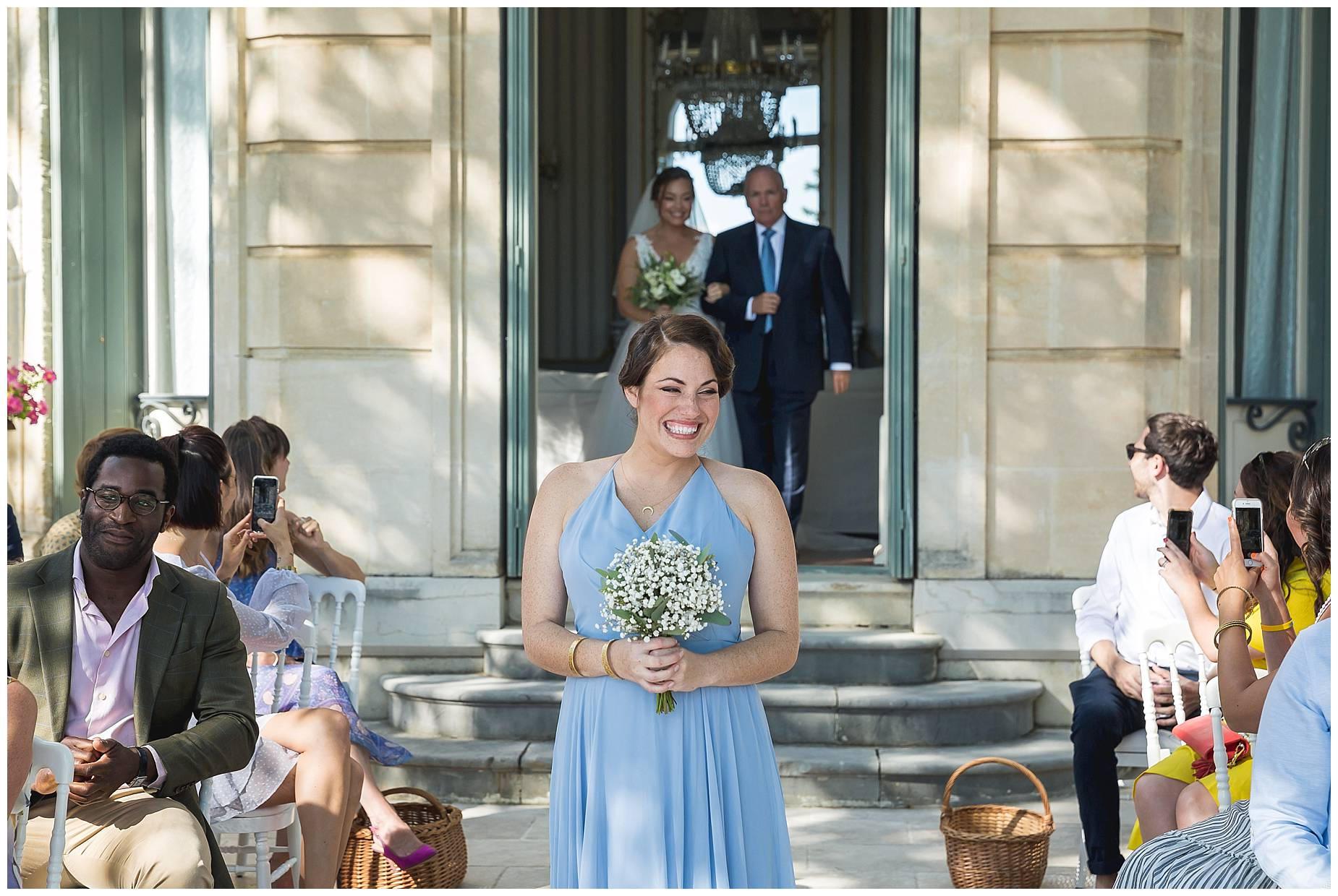 bridesmaid walks down the aisle at Chateau de Malmont Wedding