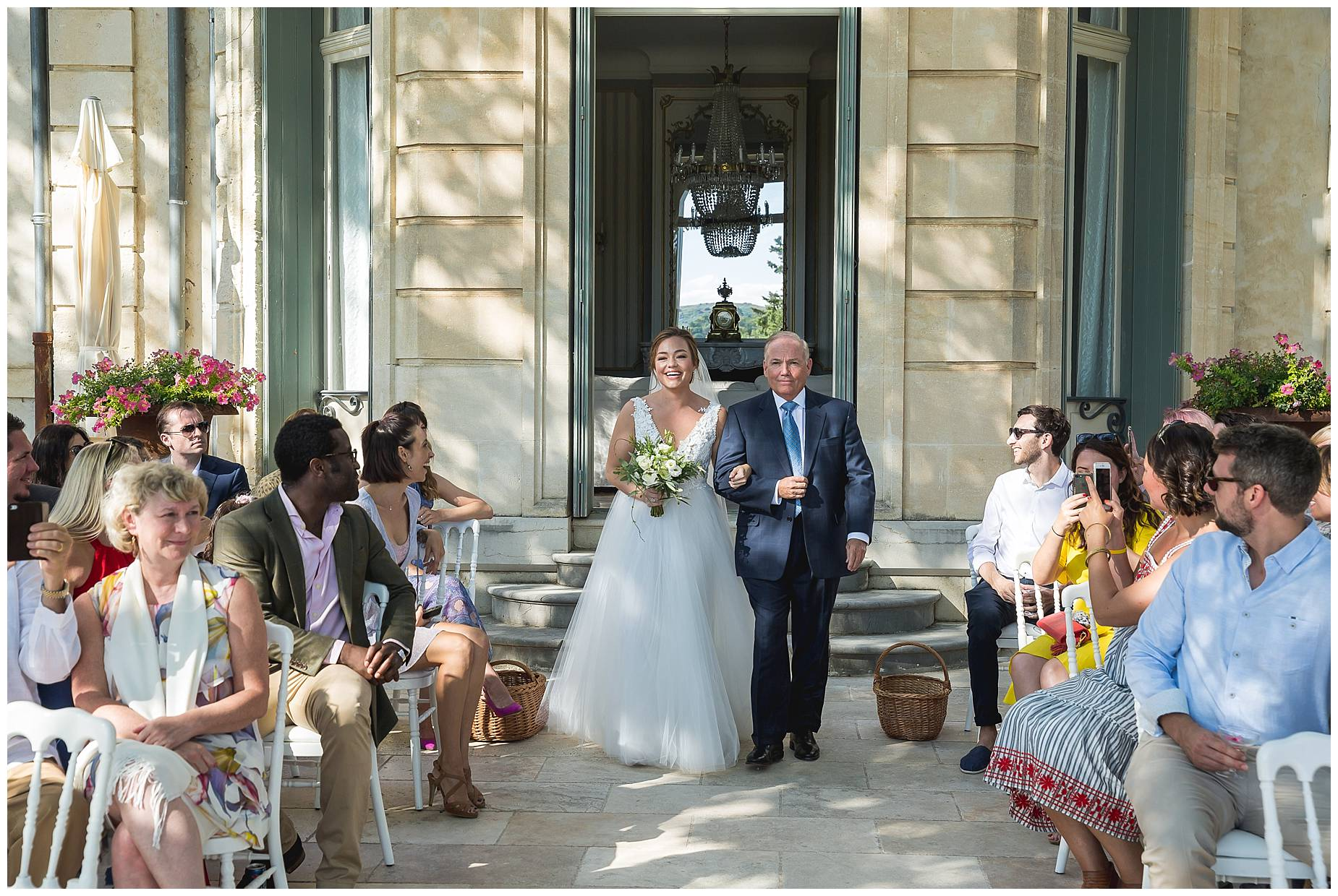bride walks down the aisle at Chateau de Malmont Wedding