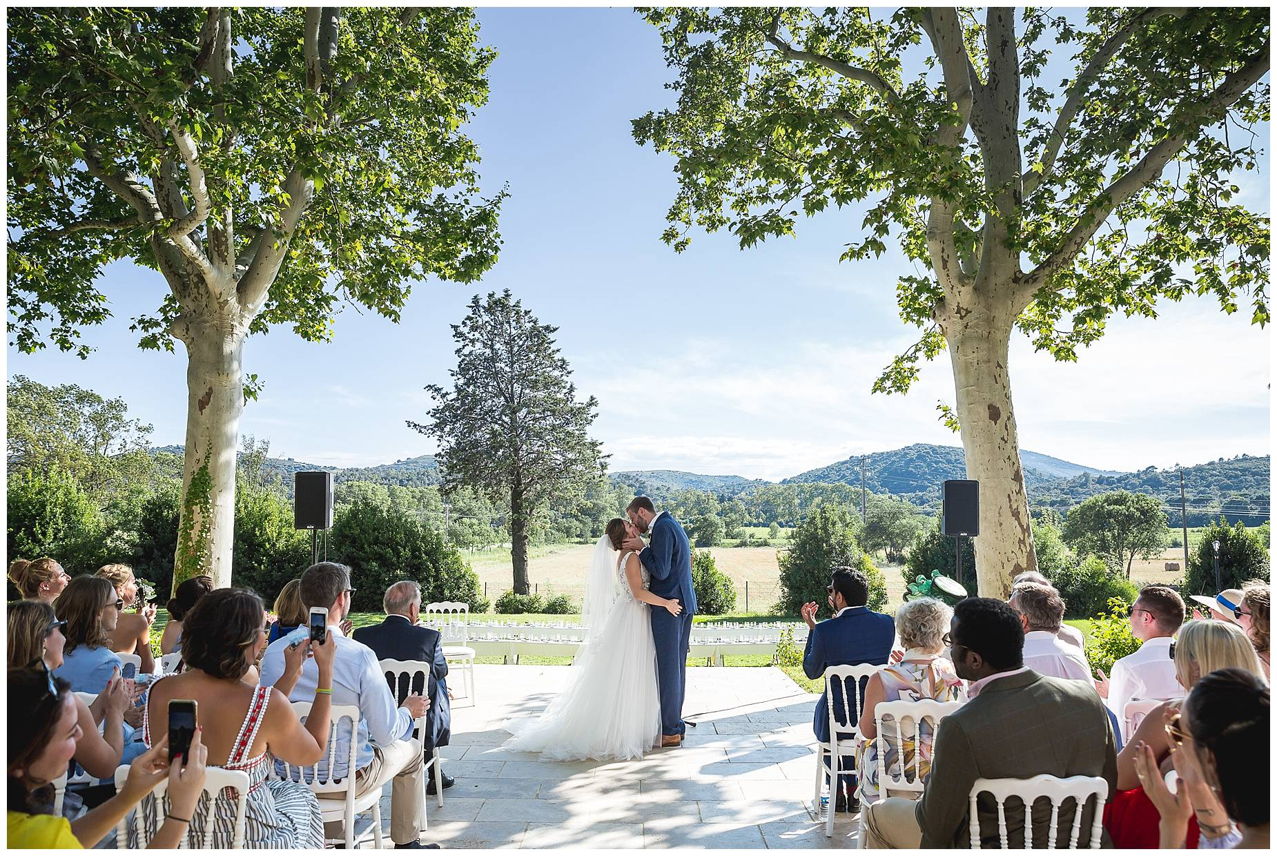 Bride and groom kiss at Chateau de Malmont Wedding
