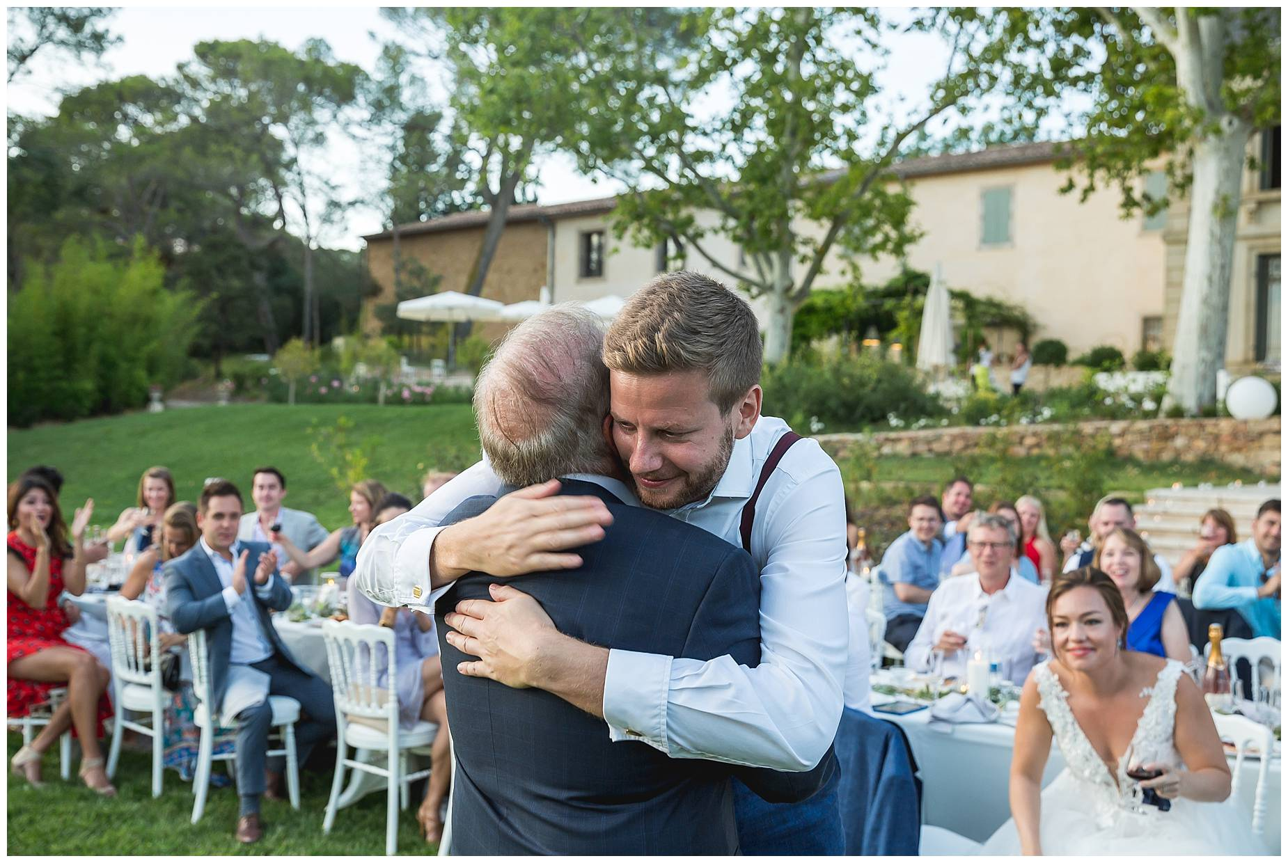 groom hugs Dad