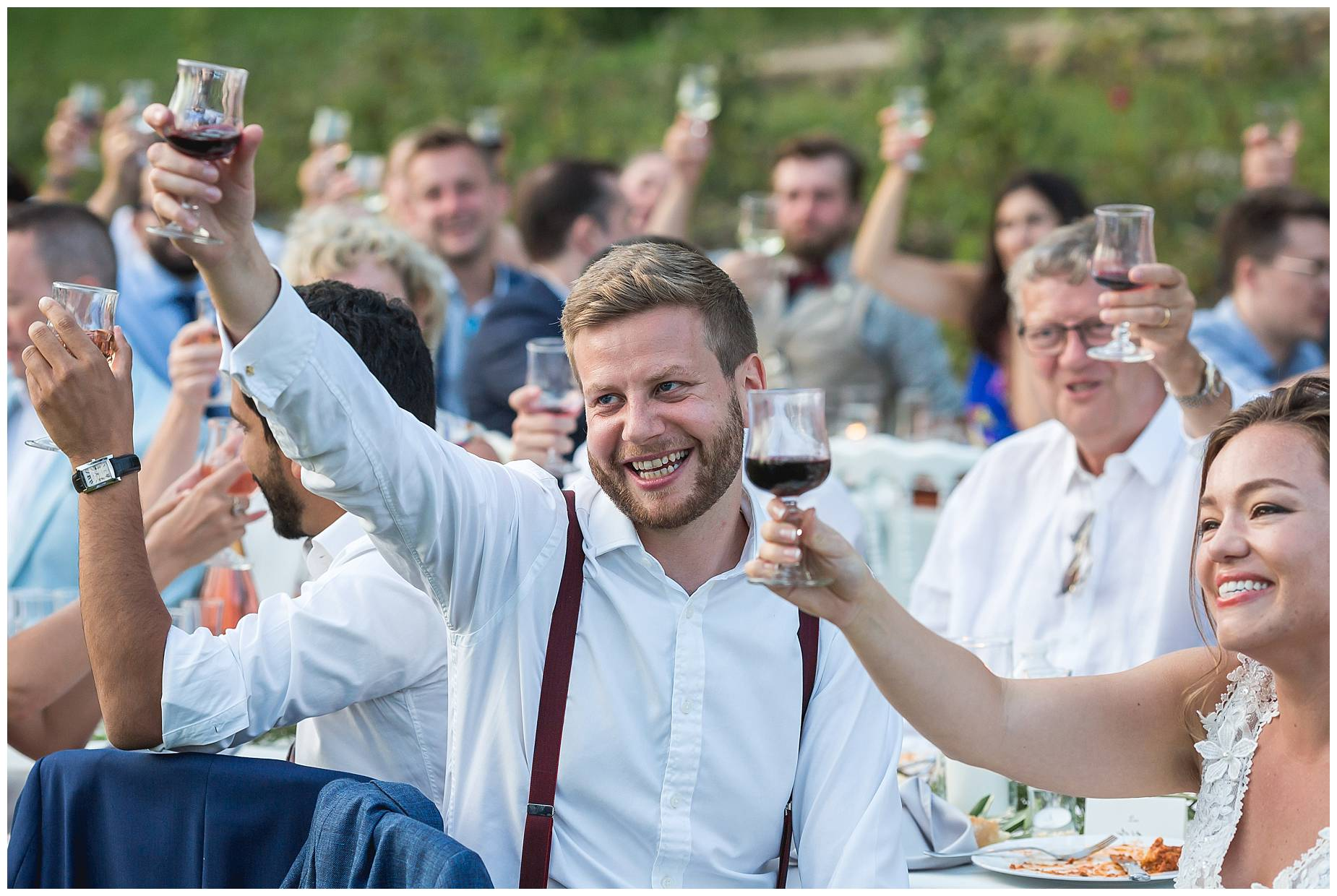 Everyone toasts to the couple at their Chateau de Malmont Wedding