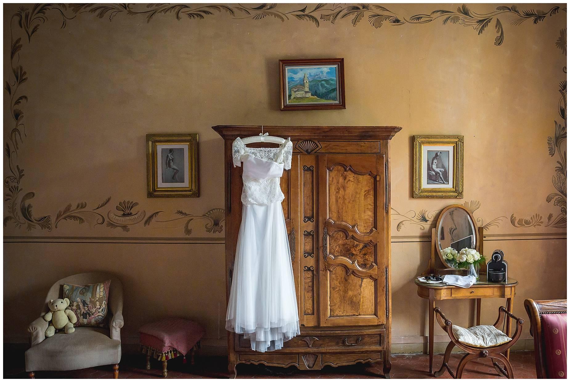 dress hanging at Chateau de Pouget Wedding