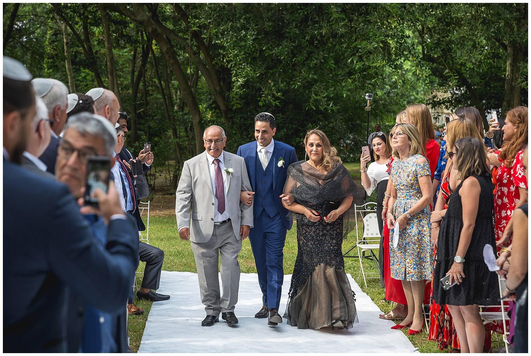 groom walk down aisle