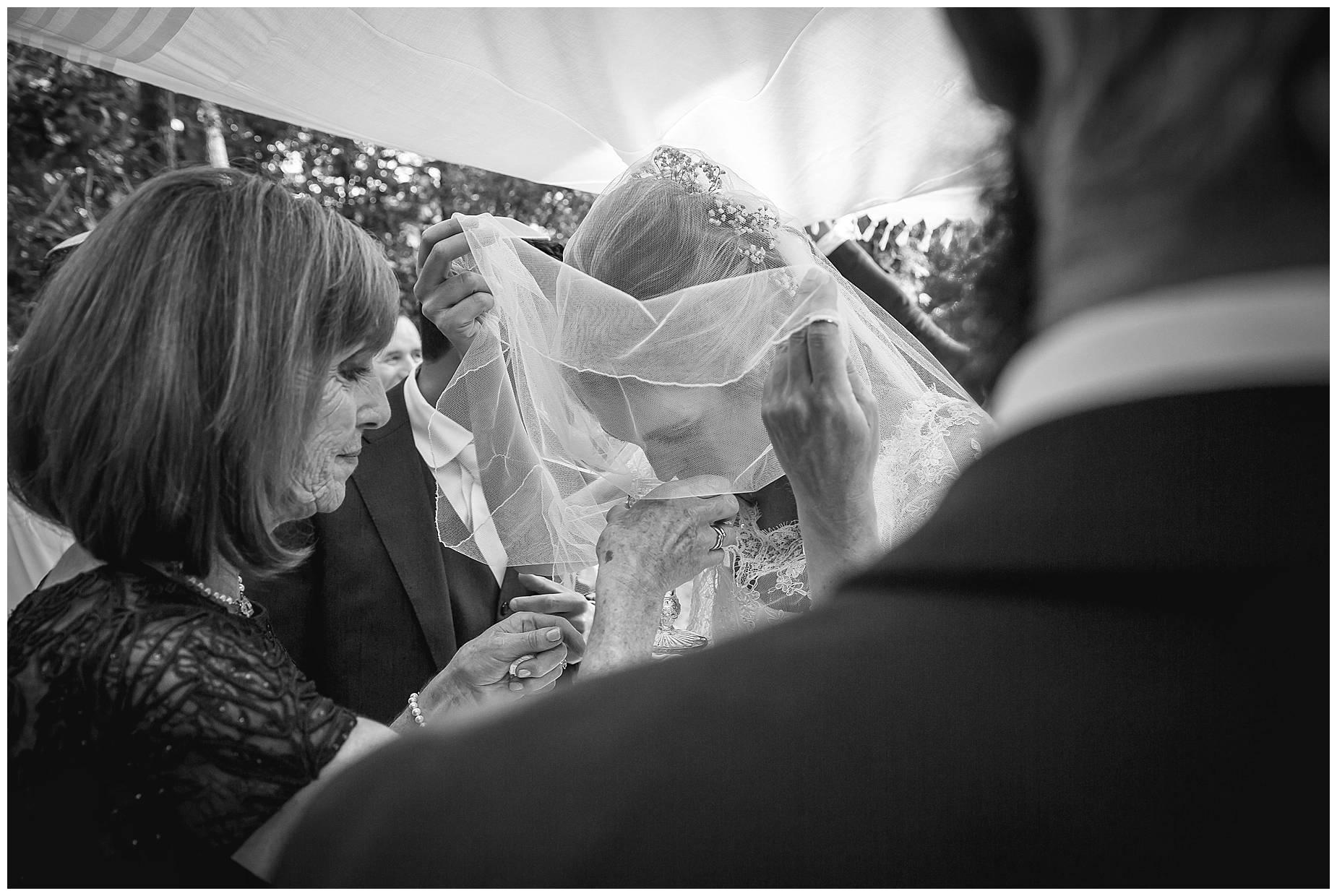 bride takes sip of wine