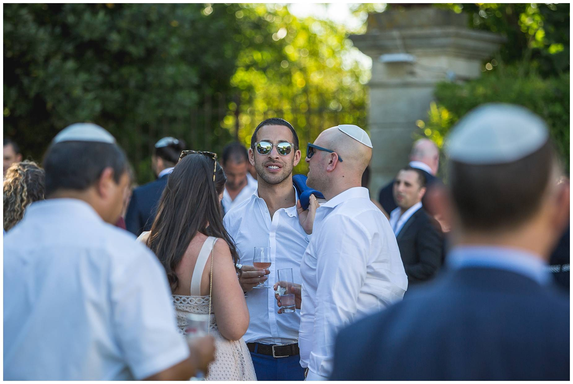 guests enjoy champagne at Chateau de Pouget Weddng