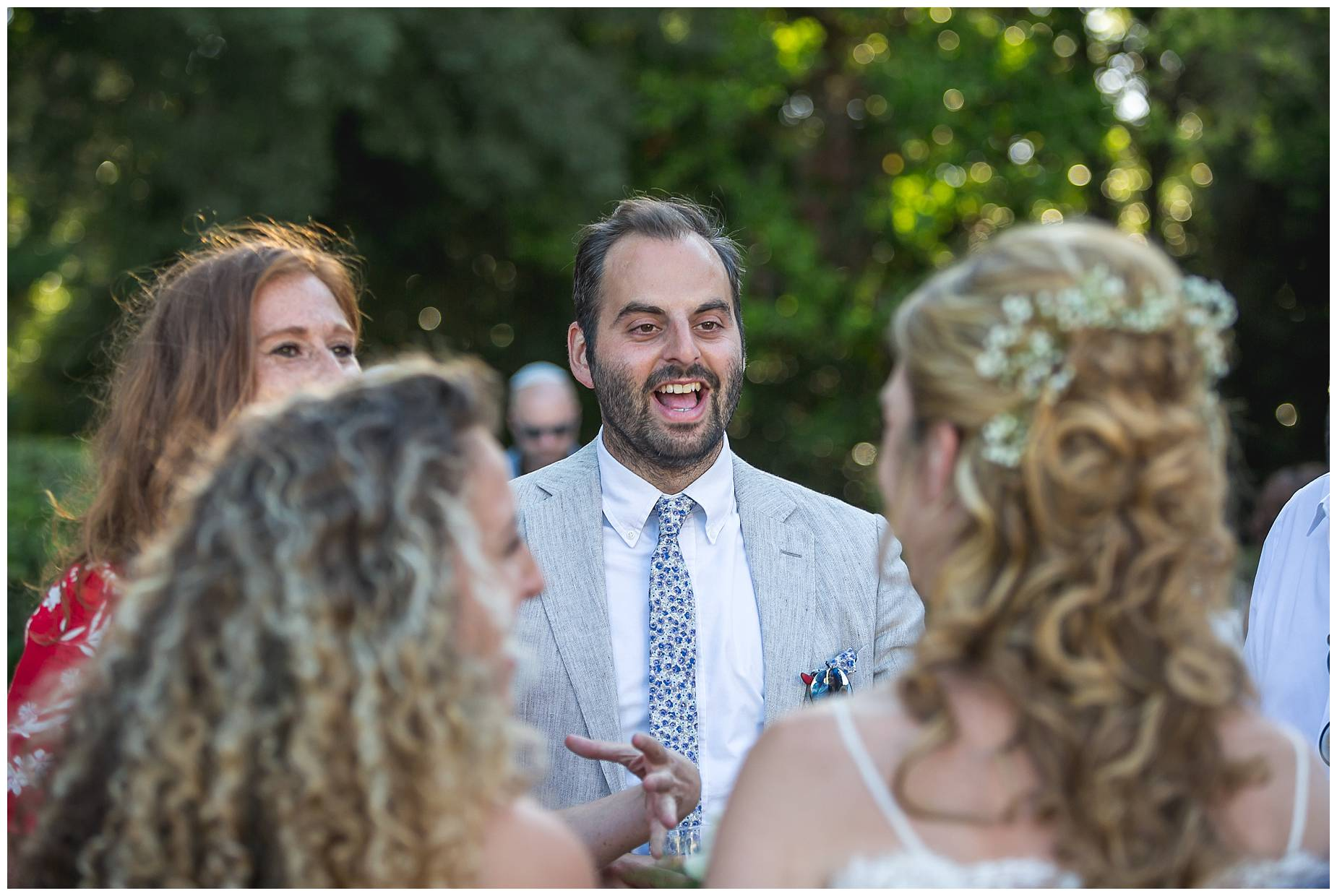 guests smile at bride