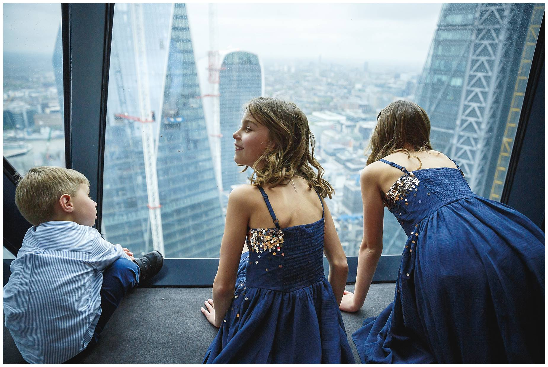 bridesmaids look at the view from the gherkin