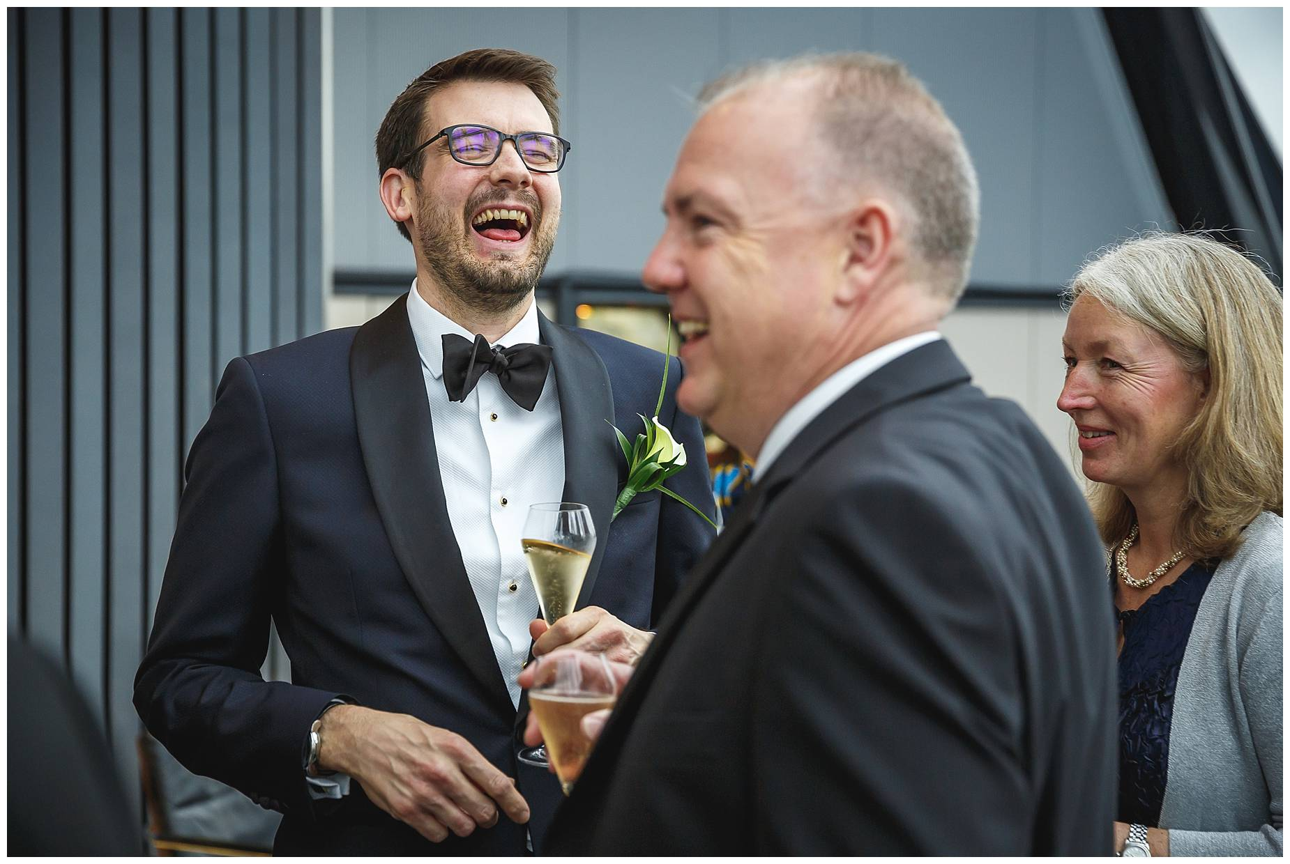 groom laughs at the gherkin