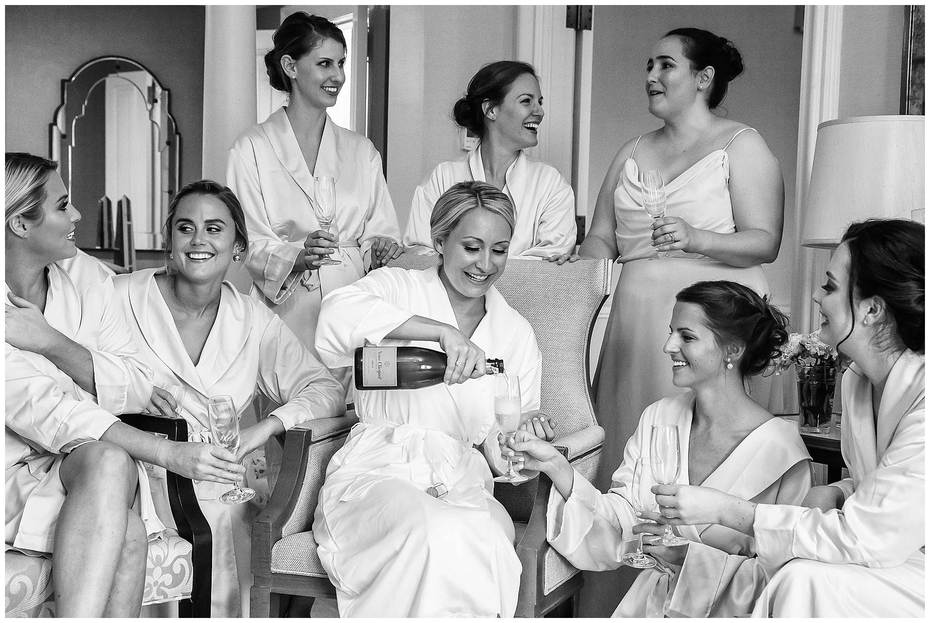 girls drink champagne in dressing gown