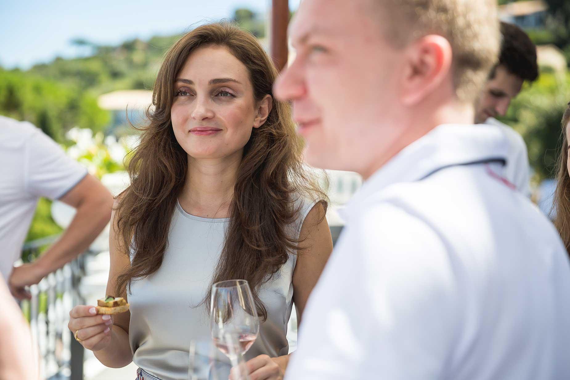bride and groom taste wine
