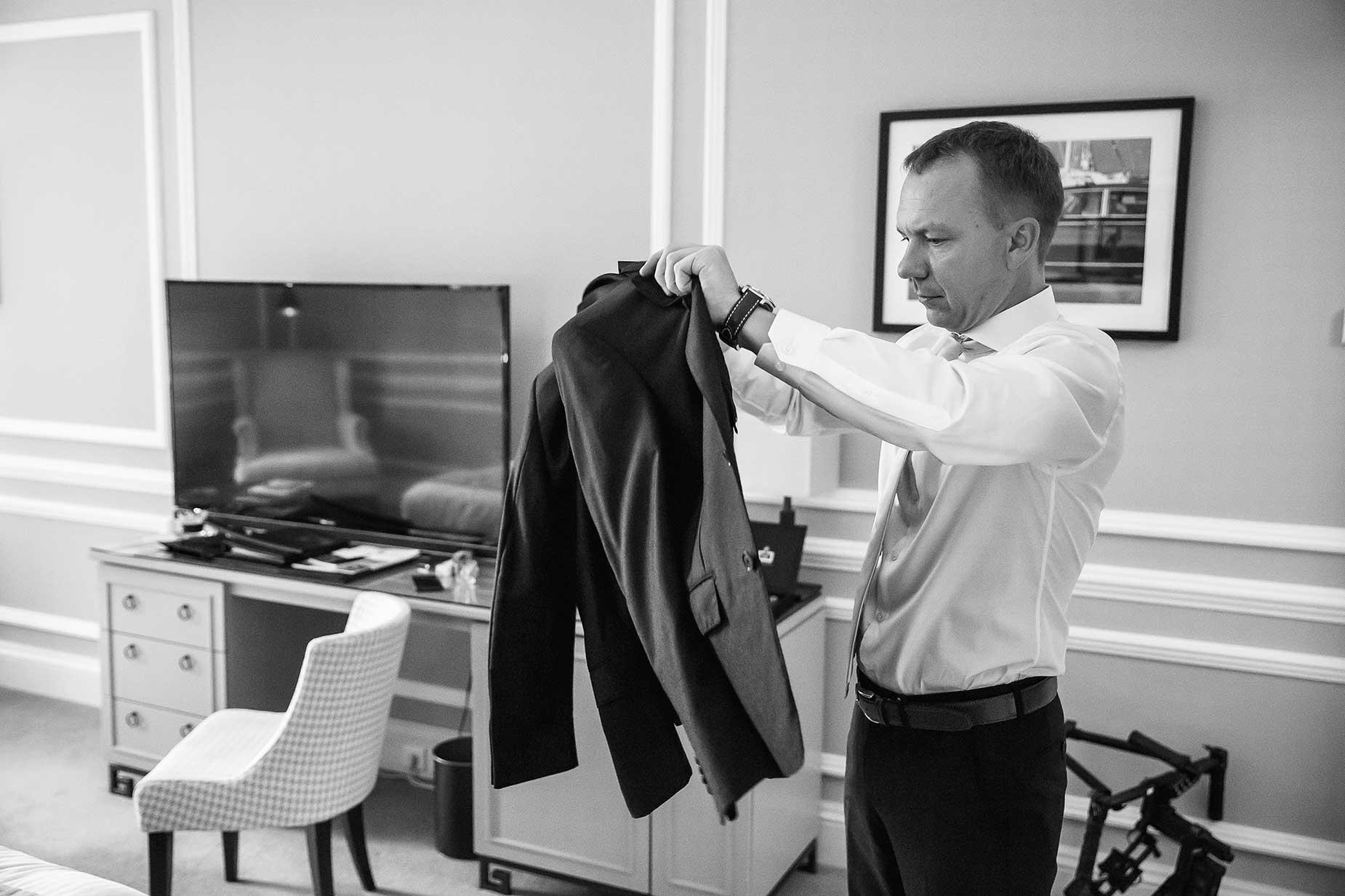 groom puts on jacket