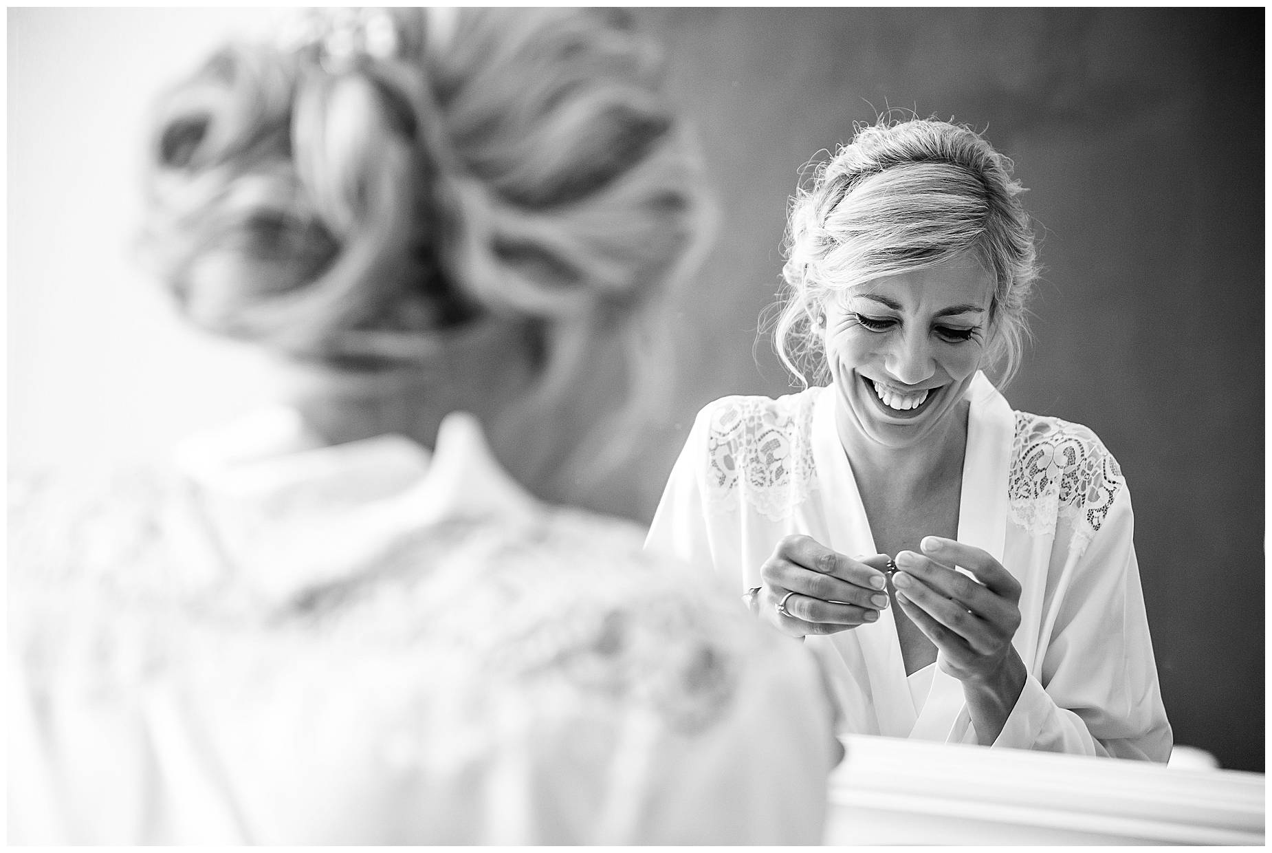 Chateau Blomac Wedding bride putting on earrings