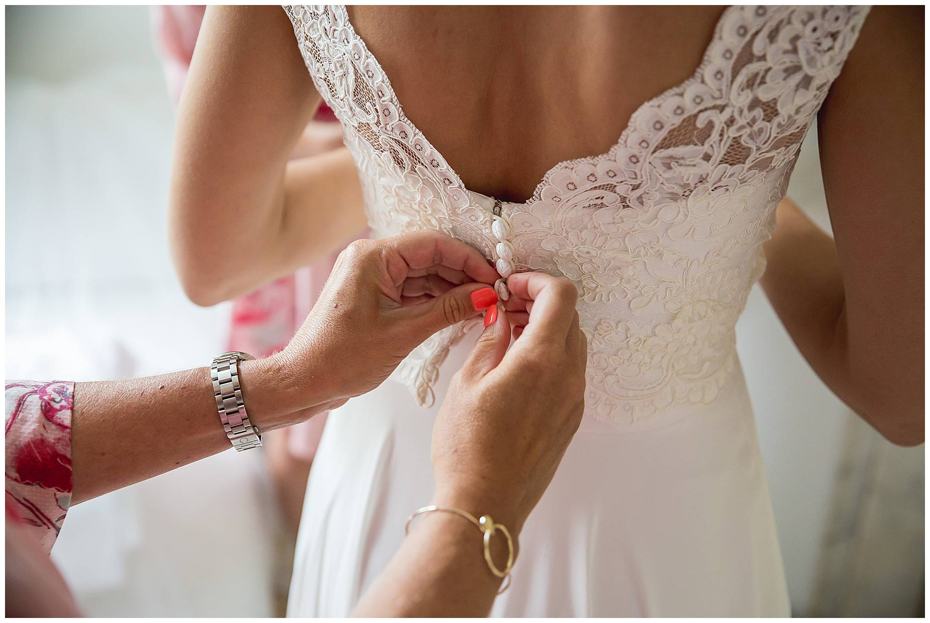fingers doing up wedding dress