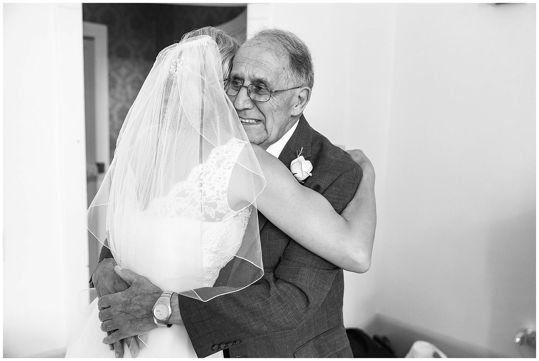 bride hugging Dad at Chateau Blomac Wedding
