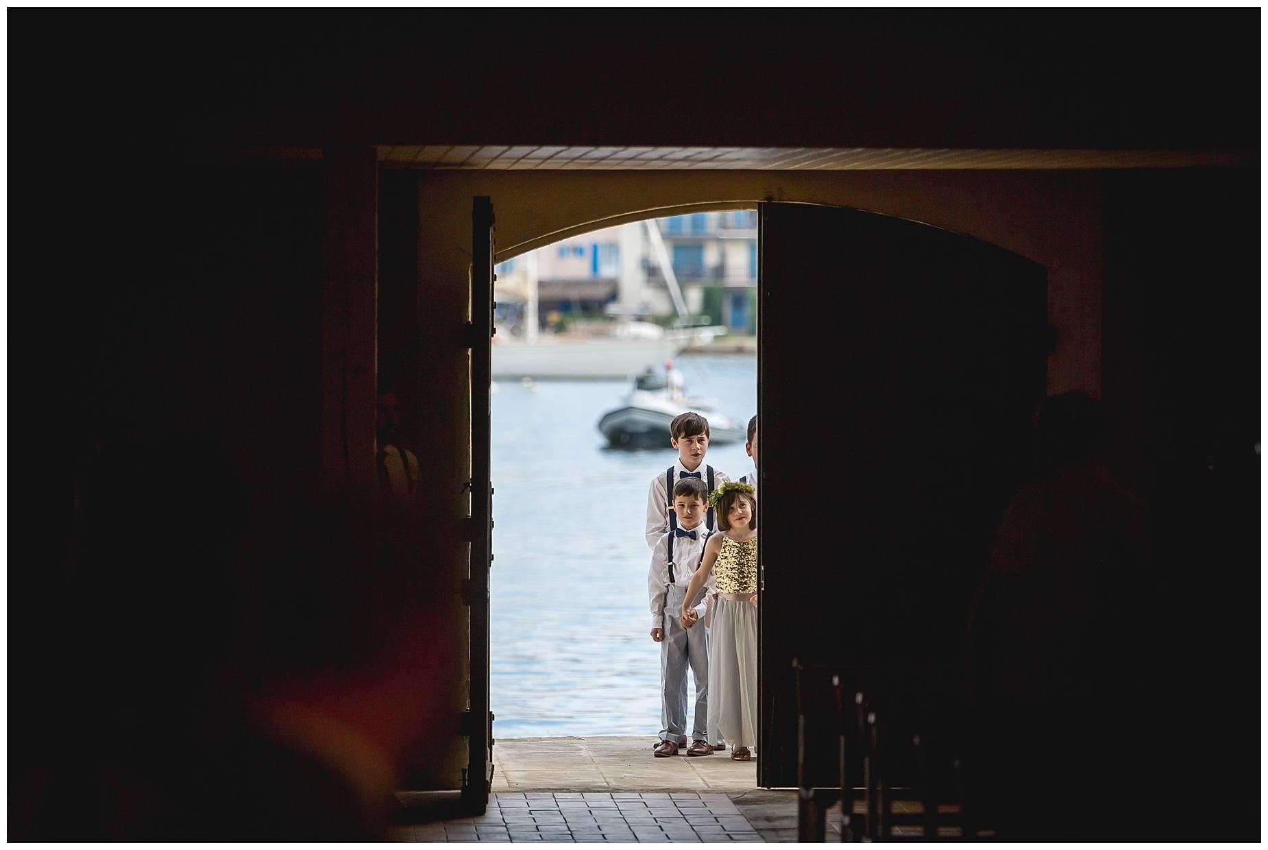 Port Grimaud Wedding kids waiting to go inside the church